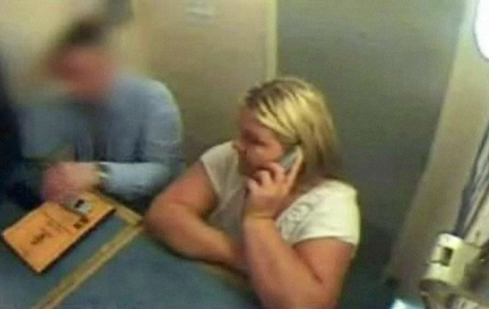 Undated Devon and Cornwall Police undated CCTv footage of Vanessa George on the phone to her lawyer while in police custody in Plymouth.