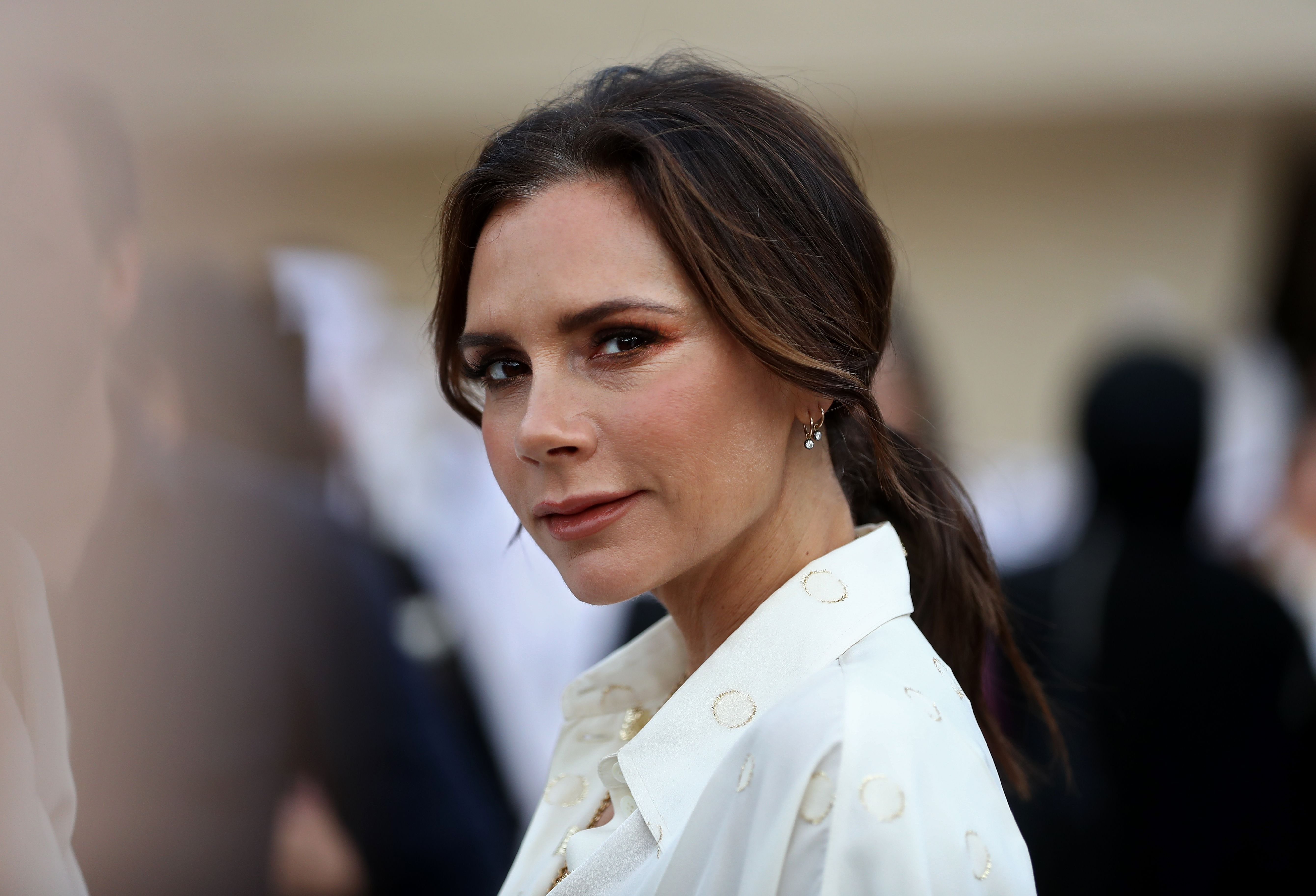 British singer and fashion designer Victoria Beckham attends the official opening ceremony for the National Museum of Qatar, in the capital Doha on March 27, 2019. - The complex architectural form of a desert rose, found in Qatars arid desert regions, inspired the striking design of the new museum building, conceived by celebrity French architect Jean Nouvel. (Photo by KARIM JAAFAR / AFP)        (Photo credit should read KARIM JAAFAR/AFP/Getty Images)