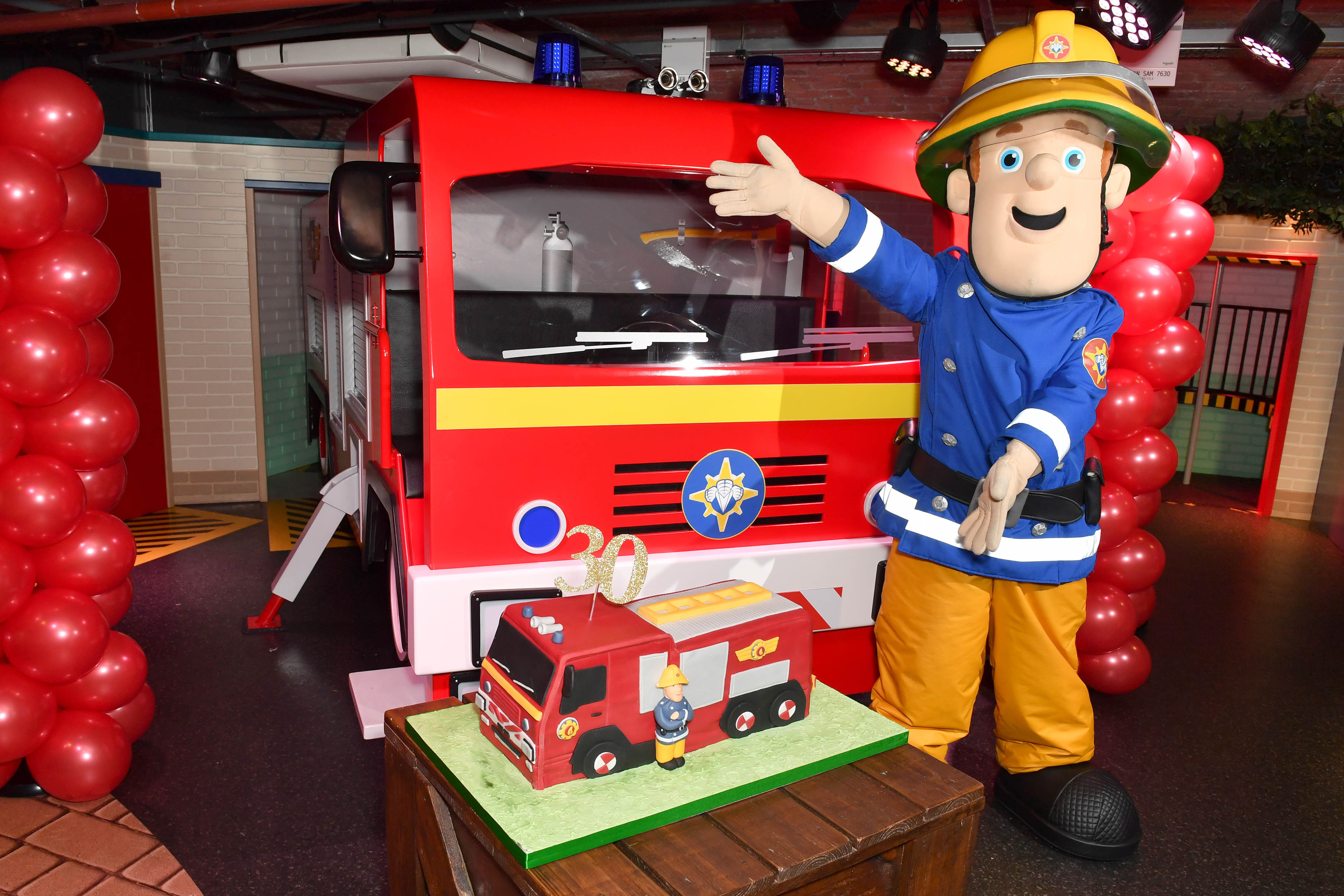 EDITORIAL USE ONLY Fireman Sam celebrates his 30th anniversary at a special birthday party held at Mattel Play! Liverpool at the Albert Dock.