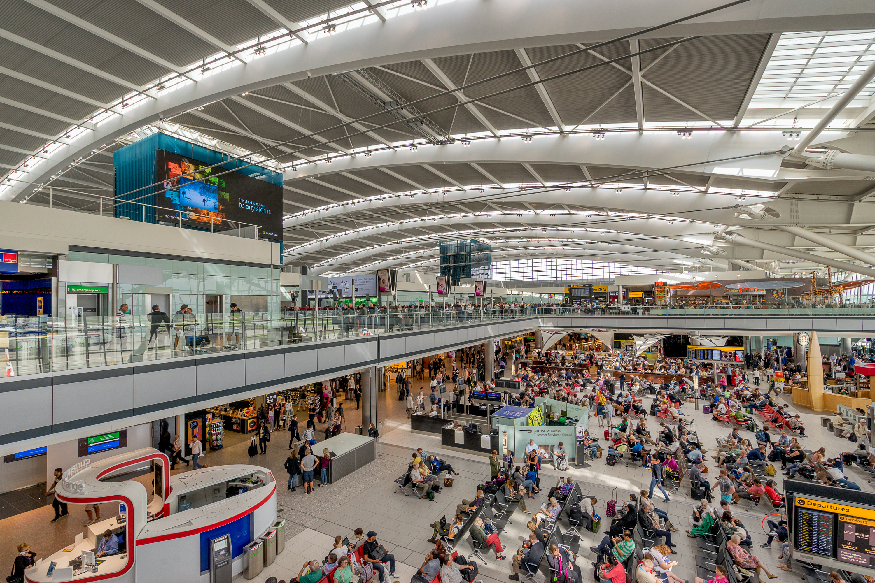 London, England - September 1, 2015: Heathrow Terminal 5 is an airport terminal at Heathrow Airport serving the UK city of London. Opened in 2008, the main building in the complex is the largest free-standing structure in the United