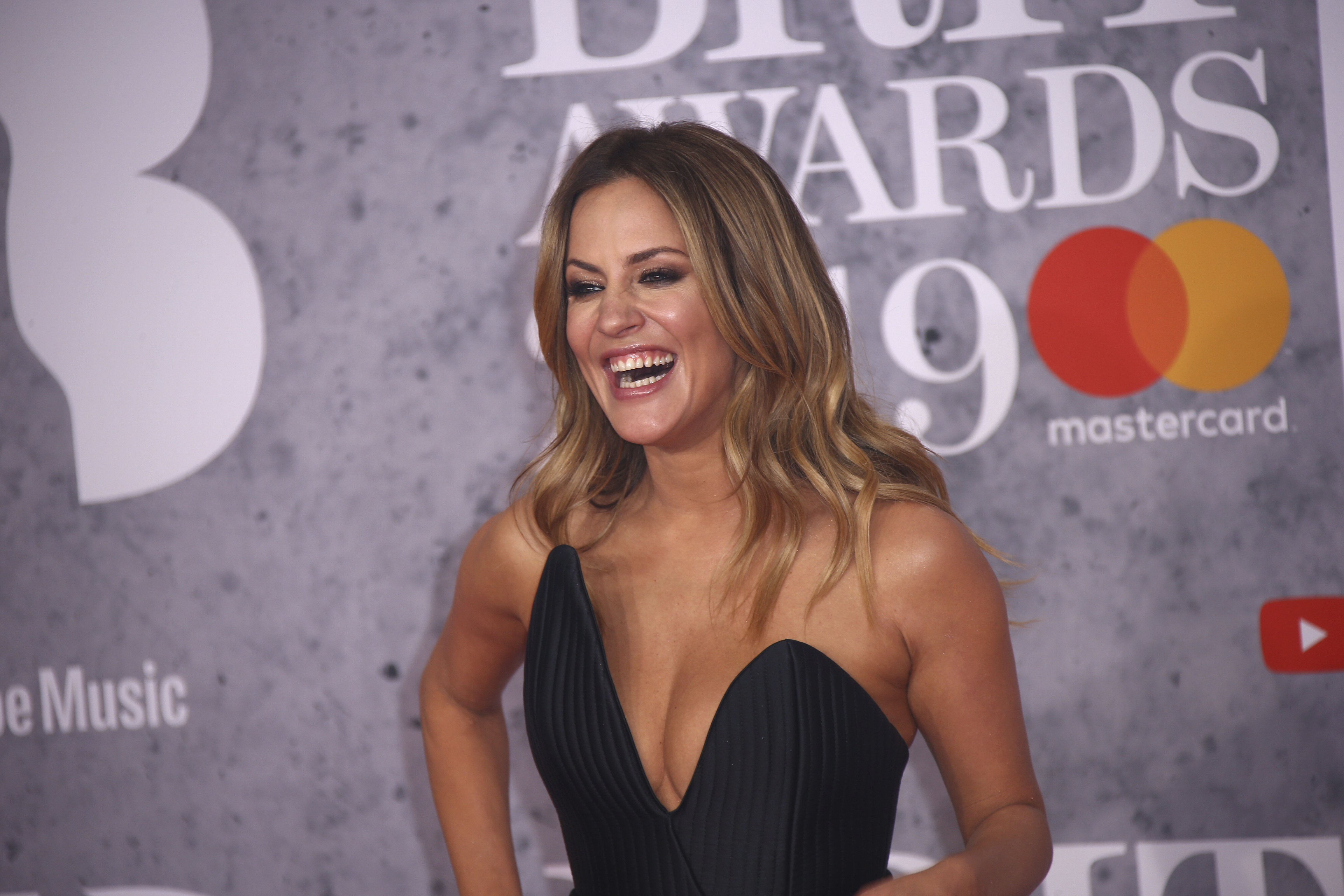 Television presenter Caroline Flack poses for photographers upon arrival at the Brit Awards in London, Wednesday, Feb. 20, 2019. (Photo by Joel C Ryan/Invision/AP)