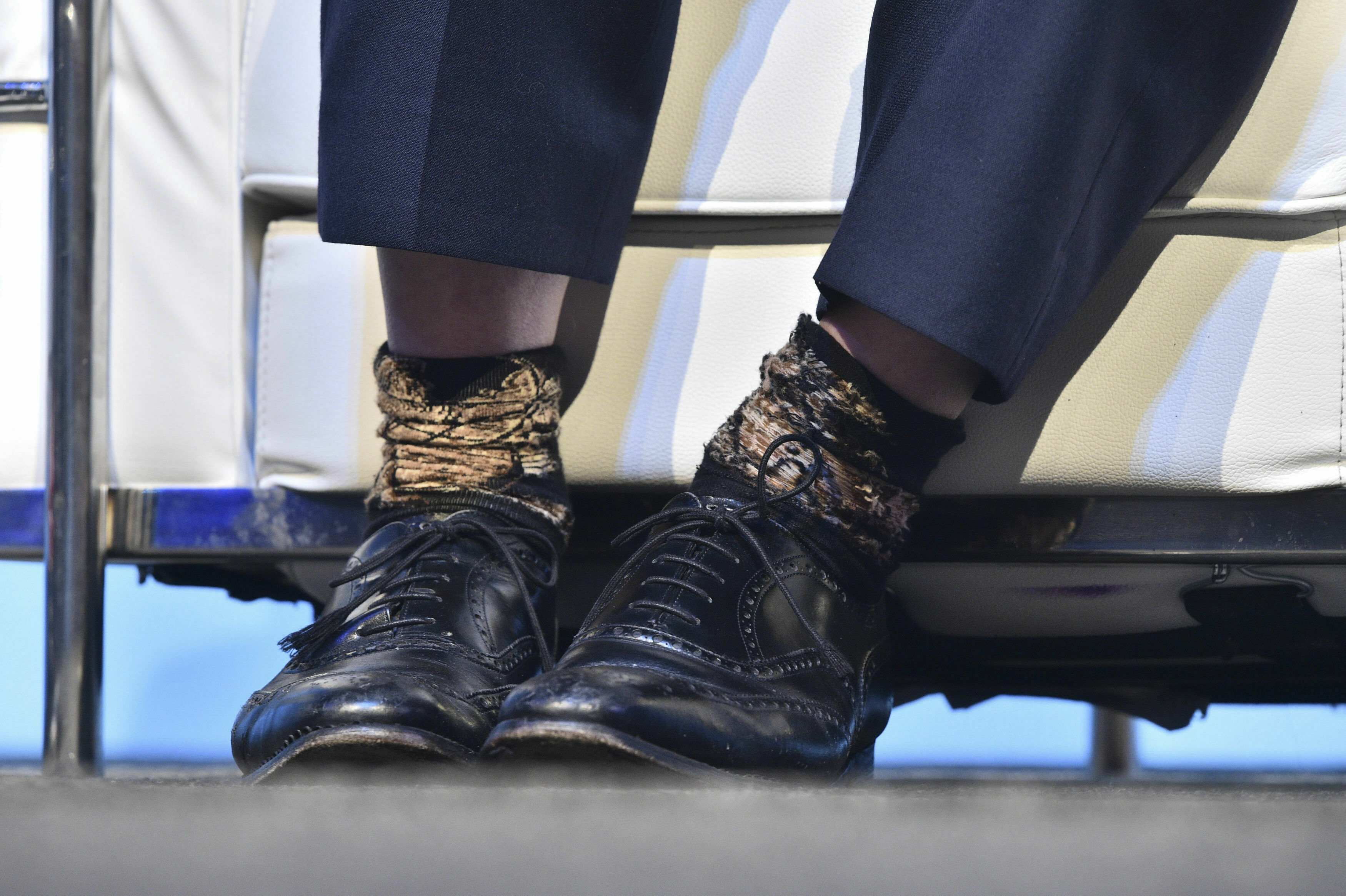 Conservative party leadership candidate Boris Johnson wearing one sock inside out, during the first party hustings at the ICC in Birmingham, England, Saturday June 22, 2019. The two finalists in the race to lead Britain's governing Conservative Party and become the country's new prime minister made their first formal pitches to party members Saturday.  (Ben Birchall/PA via AP)