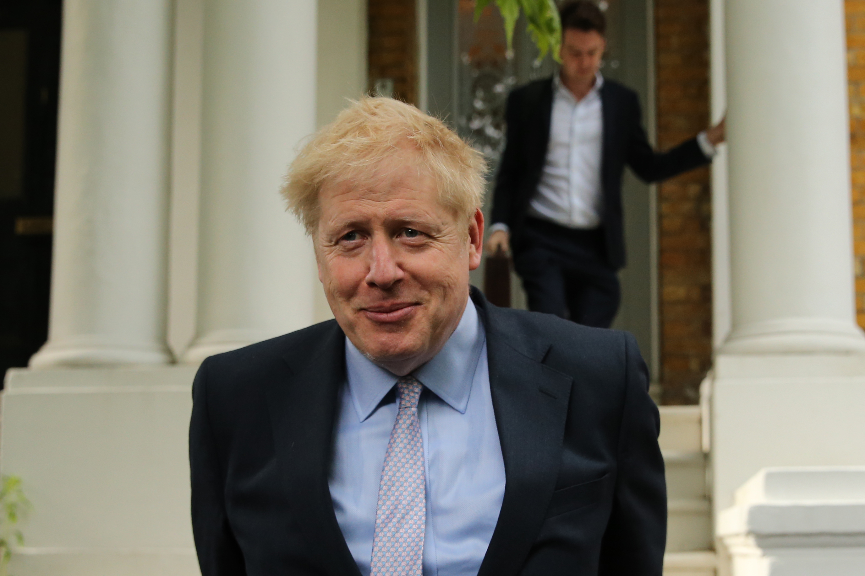 The poll by ComRes suggests that Boris Johnson would win a general election with a 140-seat majority (ISABEL INFANTES/AFP/Getty Images)
