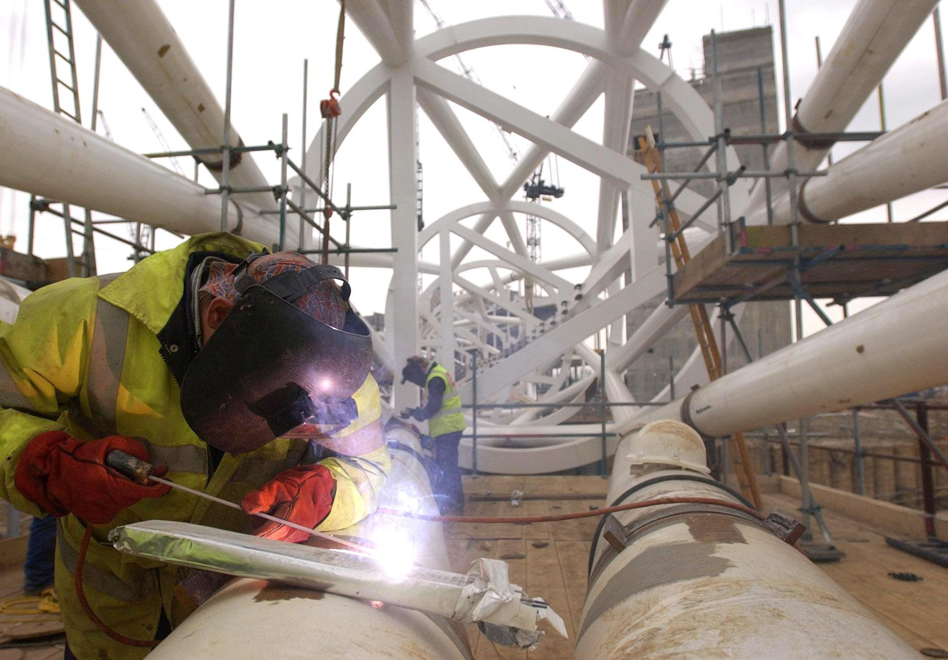 Plater Stephen Matthews welds the last piece of the arch during the construction of the new Wembley Stadium, clearing the way for the giant structure to be lifted into place within weeks. The new stadium, which is being built on the site of the old Wembley stadium in north-west London, should be completed in early 2006 and will seat 90,000 spectators.   04/03/04: Vacancies in construction and metal trades are becoming increasingly difficult to fill, highlighting a shortage of skilled workers, a new report showed. Firms are reporting a low number of applicants with the necessary skills, experience or qualifications, research found.