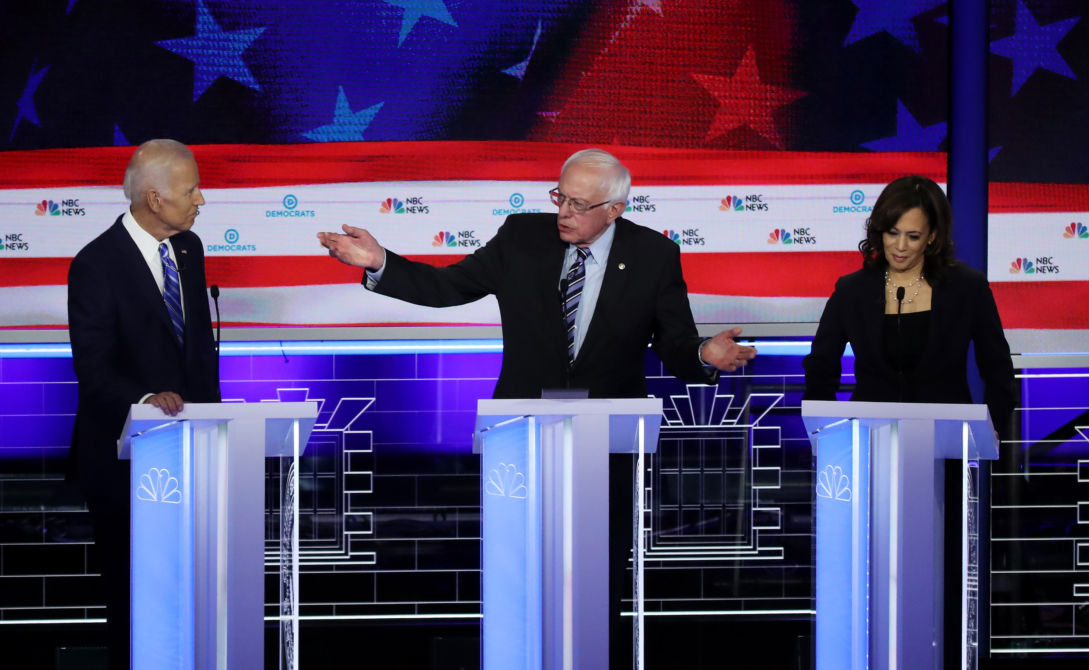 Democratic presidential candidates Vice President Joe Biden, left, Sen. Bernie Sanders, and Sen. Kamala Harris during the second night of the first Democratic presidential debates. (Photo: Drew Angerer/Getty Images)