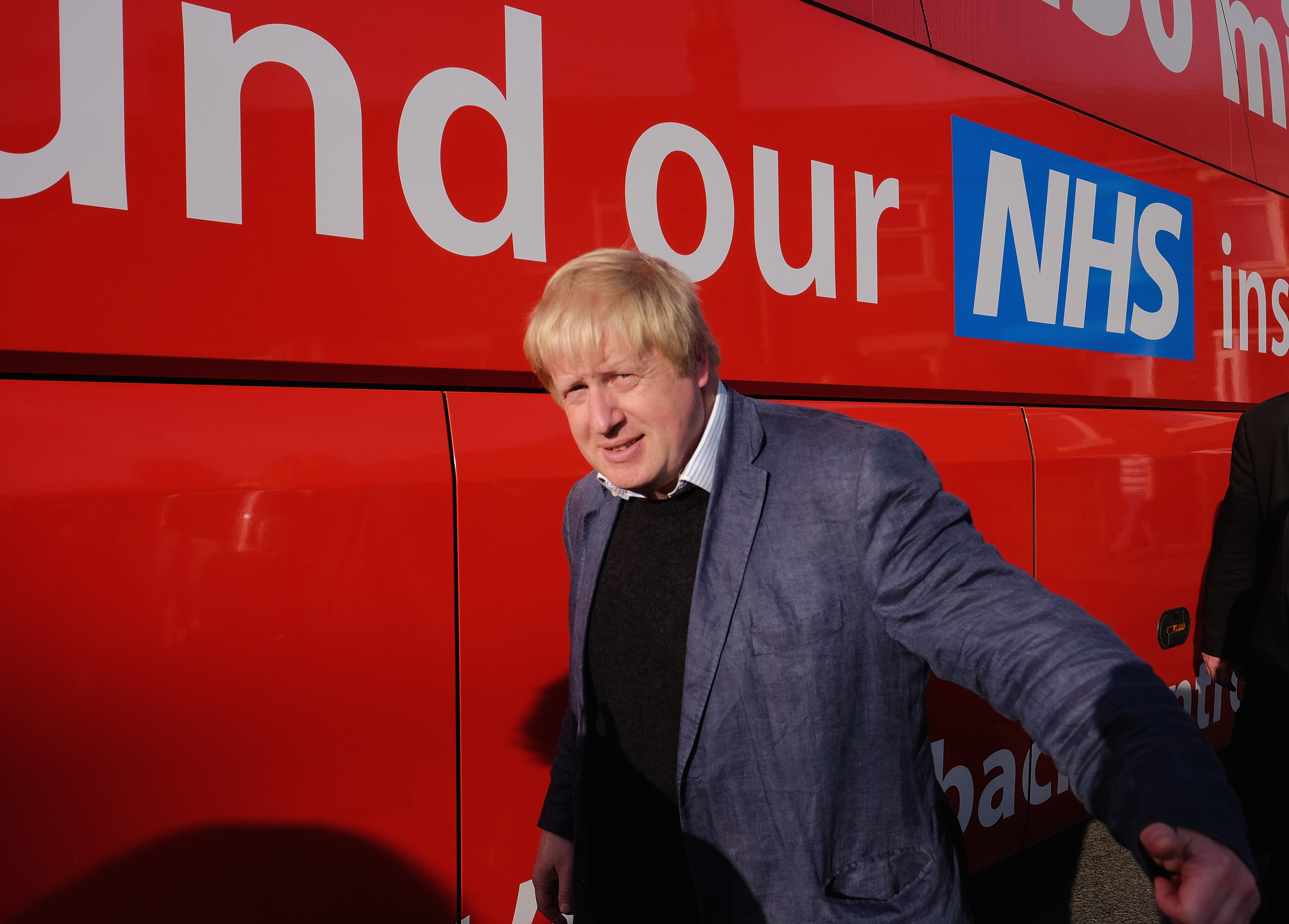 CHESTER-LE-STREET, ENGLAND - MAY 30: Boris Johnson MP walks past the battle bus during a visit Chester-Le-Street Cricket Club as part of the Brexit tour on May 30, 2016 in Chester-Le-Street, England. Boris Johnson and the Vote Leave campaign are touring the UK in their Brexit Battle Bus on a campaign hoping to persuade voters to back leaving the European Union in the June 23rd referendum. (Photo by Ian Forsyth/Getty Images)