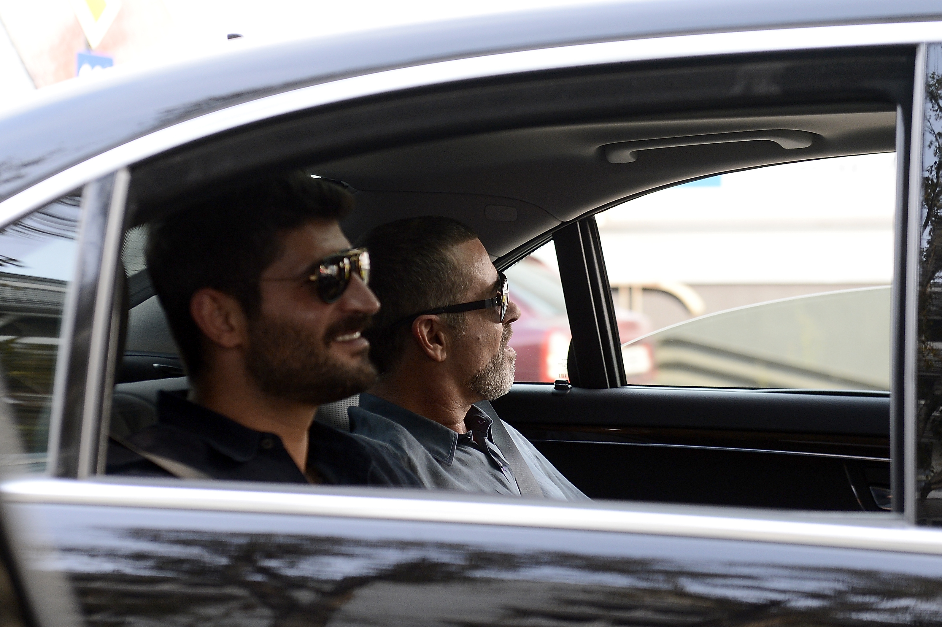 VIENNA, AUSTRIA - SEPTEMBER 04:  George Michael and  Fadi Fawaz arrive at Airport Vienna on September 4, 2012 in Vienna, Austria.  (Photo by Luca Teuchmann/Getty Images)