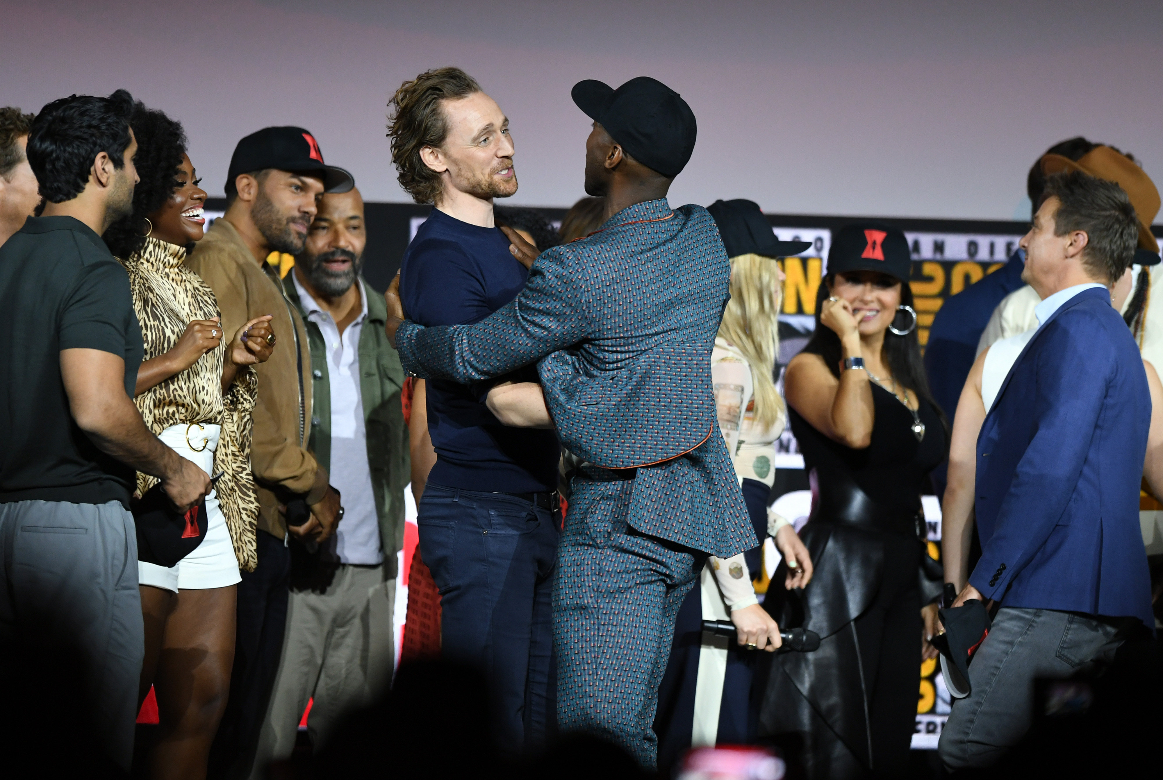 SAN DIEGO, CALIFORNIA - JULY 20: Tom Hiddleston and Mahershala Ali (C) speak at the Marvel Studios Panel during 2019 Comic-Con International at San Diego Convention Center on July 20, 2019 in San Diego, California. (Photo by Kevin Winter/Getty Images)