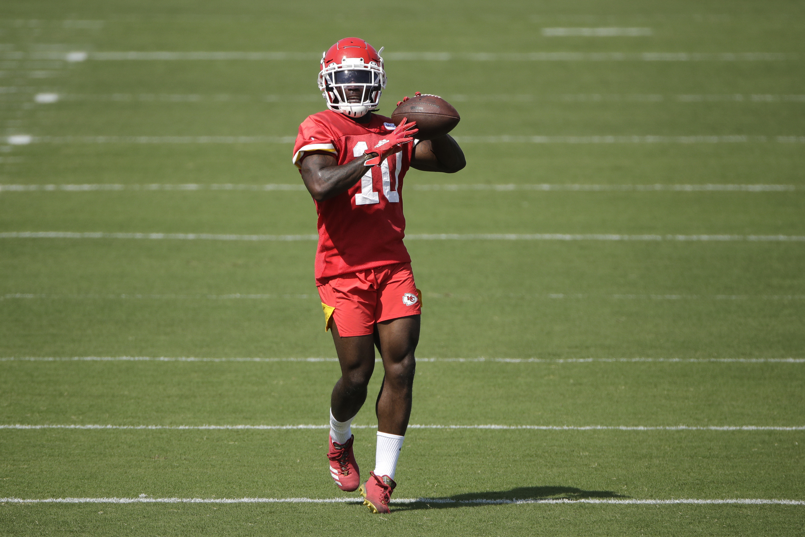 Kansas City Chiefs wide receiver Tyreek Hill throws the ball during NFL football training camp Saturday, July 27, 2019, in St. Joseph, Mo. (AP Photo/Charlie Riedel)