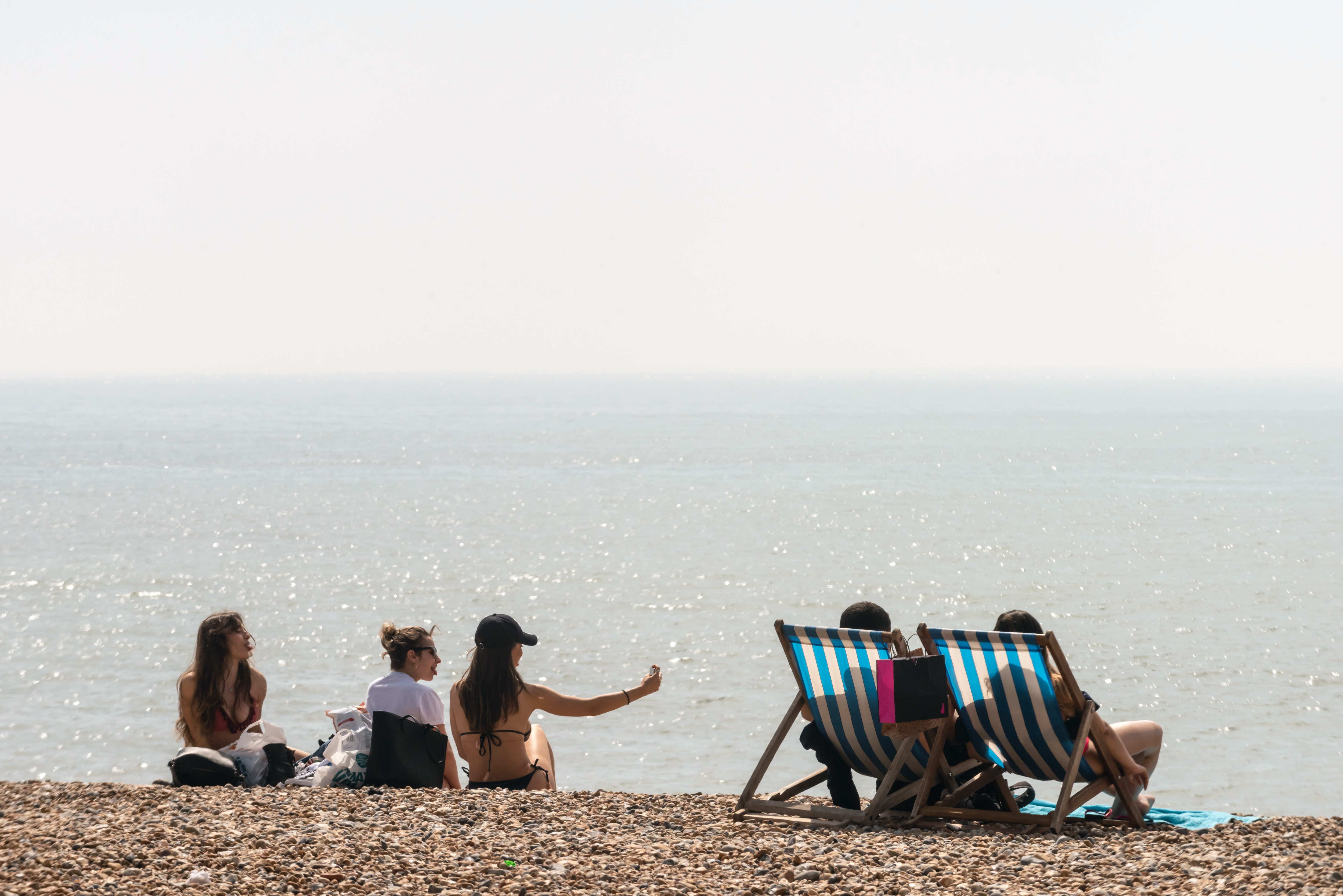 BRIGHTON, ENGLAND - APRIL 22: People enjoy the beach during the warm weather on Bank Holiday Easter Monday on April 22, 2019 in Brighton, England.  This Easter weekend has broken previous hot weather records with the warm weather expected to continue into next week. (Photo by Andrew Hasson/Getty Images)