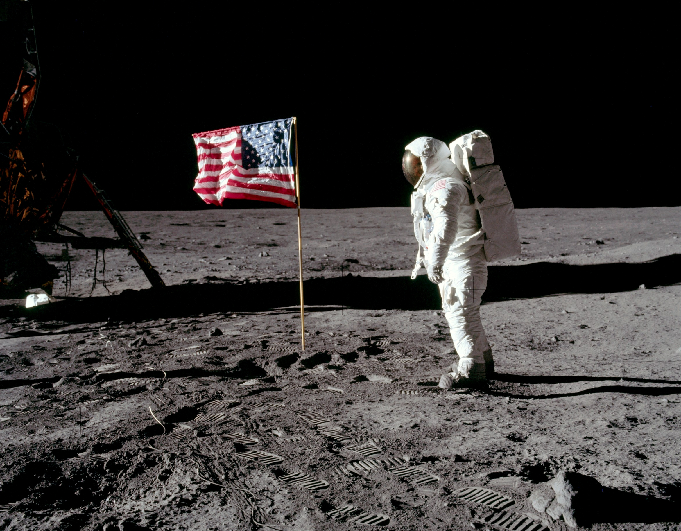 Astronaut Buzz Aldrin, lunar module pilot for Apollo 11, poses for a photograph beside the deployed United States flag during an extravehicular activity (EVA) on the moon, July 20, 1969. The lunar module (LM) is on the left, and the footprints of the astronauts are visible in the soil. Neil Armstrong/NASA/Handout via REUTERS   ATTENTION EDITORS - THIS IMAGE HAS BEEN SUPPLIED BY A THIRD PARTY