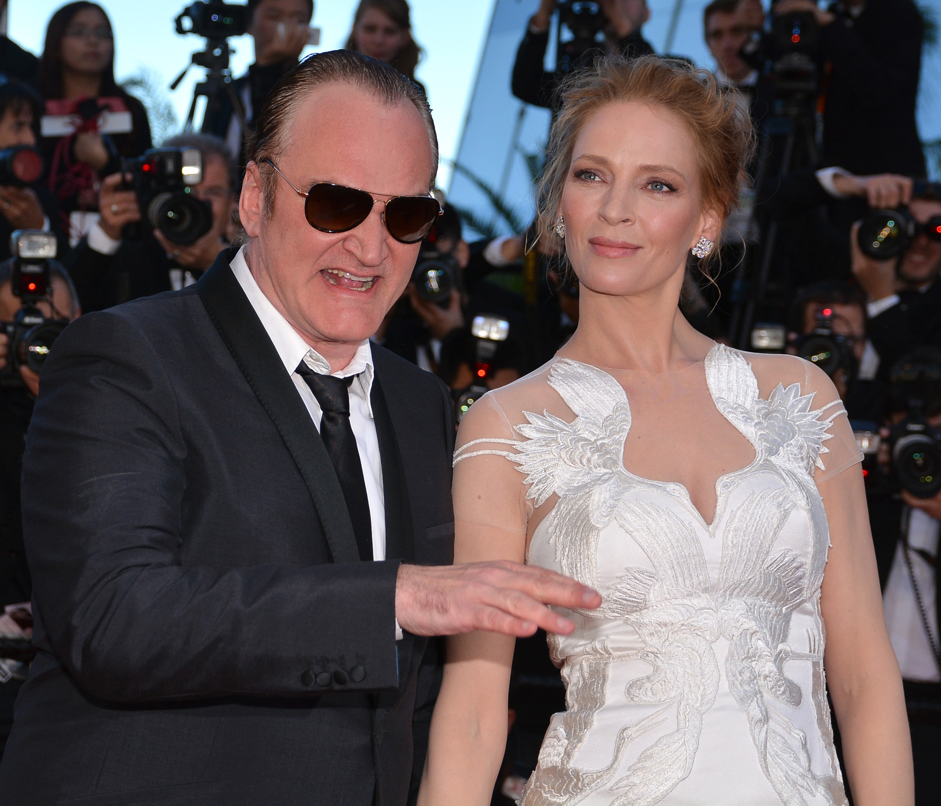 CANNES, FRANCE - MAY 24: US actress Uma Thurman (R) and US director Quentin Tarantino (L) attend the 'Per un pugno di dollari' (A Fistful of Dollars) film screening and the Closing Ceremony of the 67th Cannes Film Festival in Cannes, France on May 24, 2014. (Photo by Mustafa Yalcin/Anadolu Agency/Getty Images)