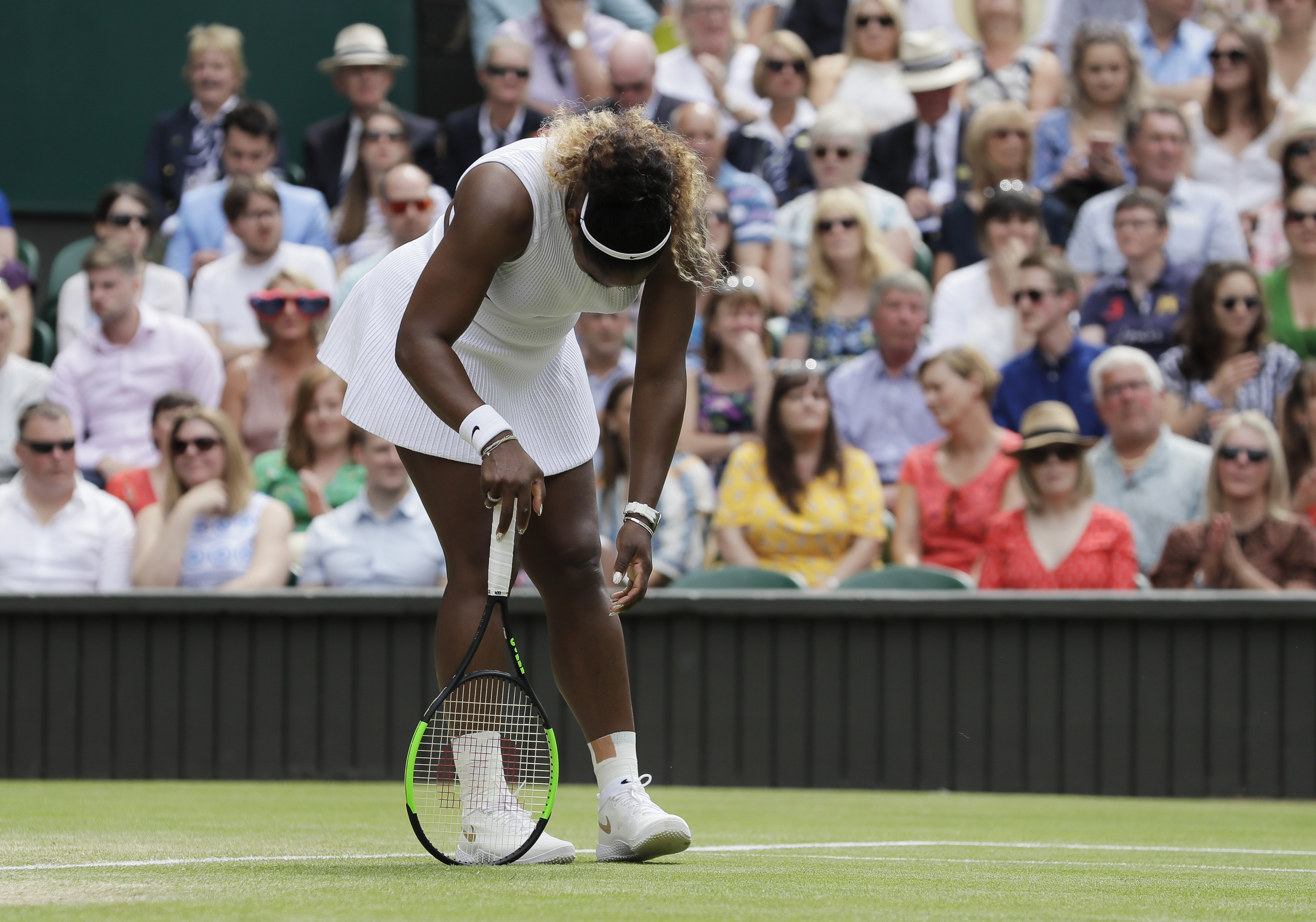 United States' Serena Williams is dejected after losing a point during the women's singles final match against Romania's Simona Halep on day twelve of the Wimbledon Tennis Championships in London, Saturday, July 13, 2019.(AP Photo/Kirsty Wigglesworth)