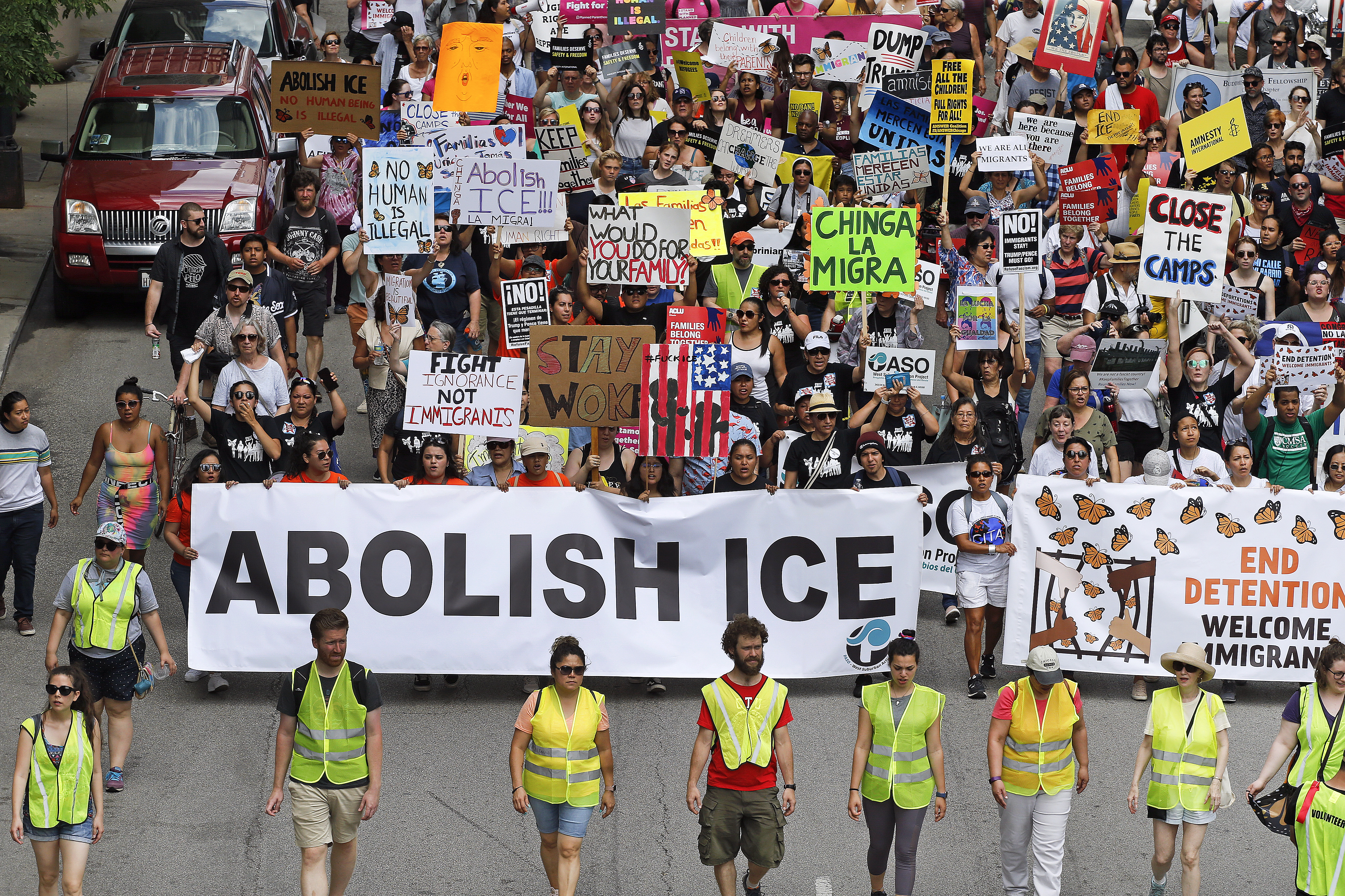 Protesters march to offices of the U.S. Immigration and Customs Enforcement on July 13, 2019 in Chicago, Ill. The rally called for an end to criminalization, detention and deportation of migrants ahead of planned ICE raids expected to the following day. (Nuccio DiNuzzo/Getty Images)