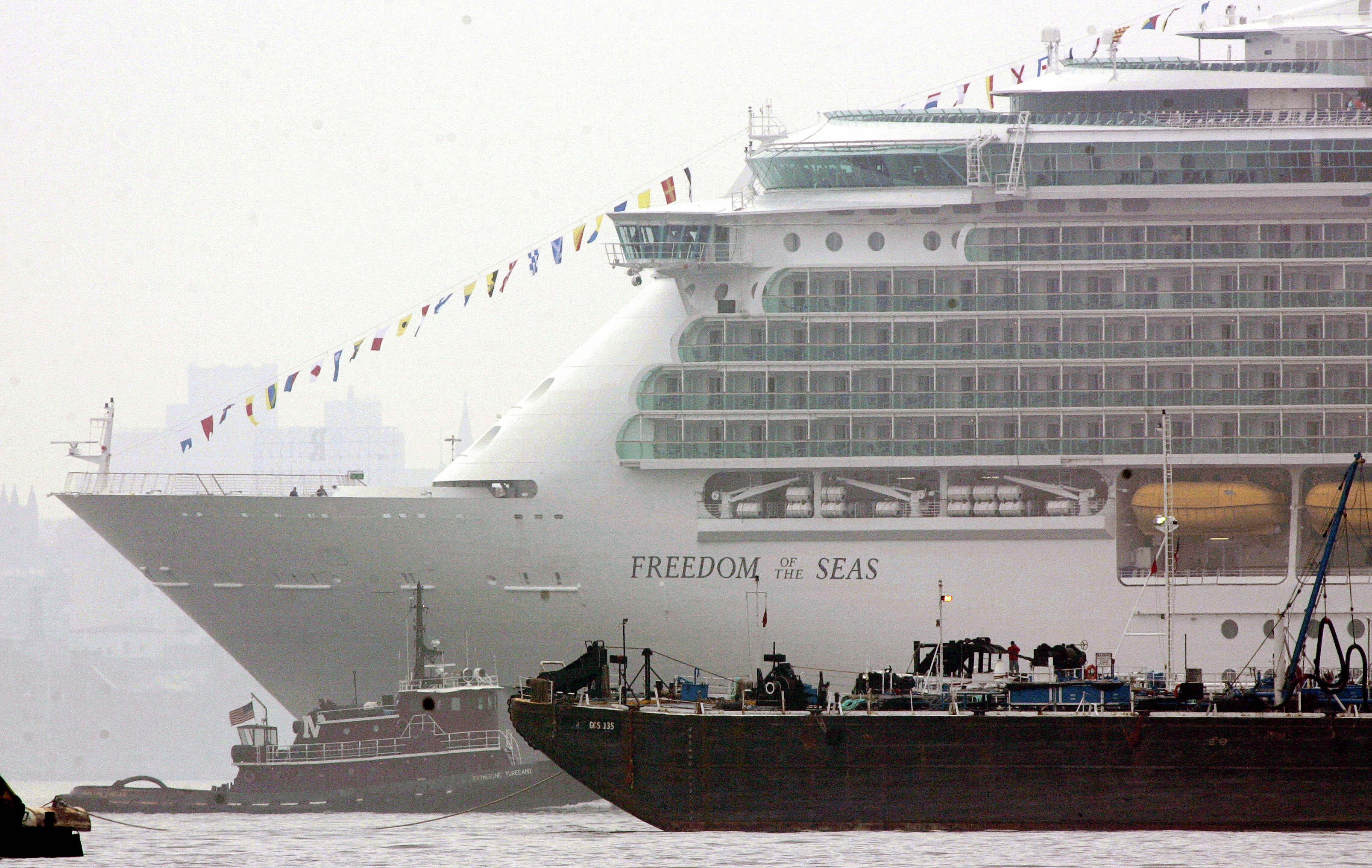 Bayonne, UNITED STATES:  The new cruise ship Freedom of the Seas, the world's largest cruise ship, owned by Royal Caribbean, gets caught in some barge traffic off the shores of Bayonne, New Jersey 12 May, 2006 in New York Harbor.   AFP PHOTO/DON EMMERT  (Photo credit should read DON EMMERT/AFP/Getty Images)
