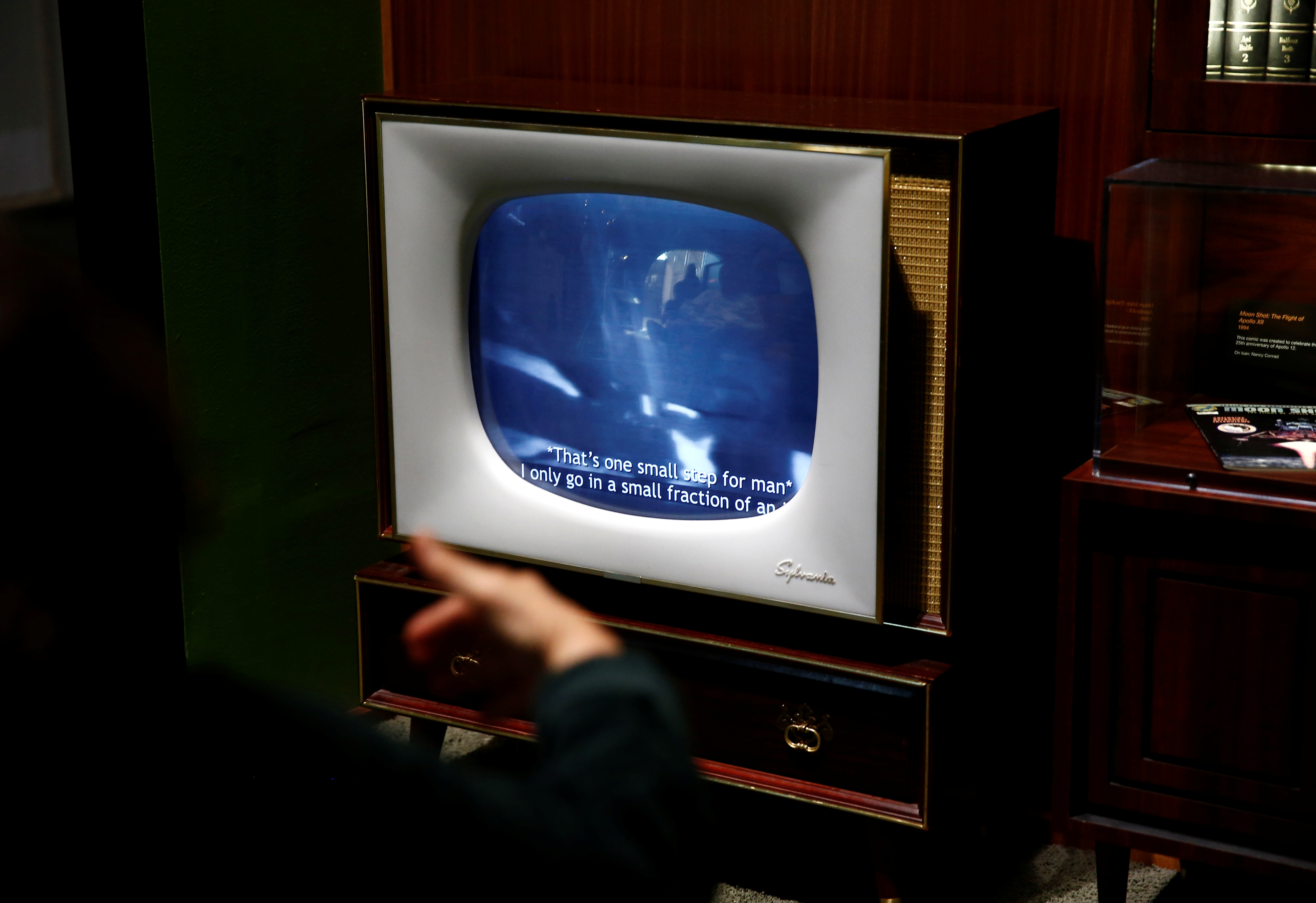 """A visitor watches footage from the moon landing in a recreated 1960s-style living room on the anniversary of the Apollo 11 mission launch at the """"Destination Moon: The Apollo 11 Mission"""" exhibit at the Museum of Flight in Seattle, Washington, U.S., July 16, 2019.   REUTERS/Lindsey Wasson"""