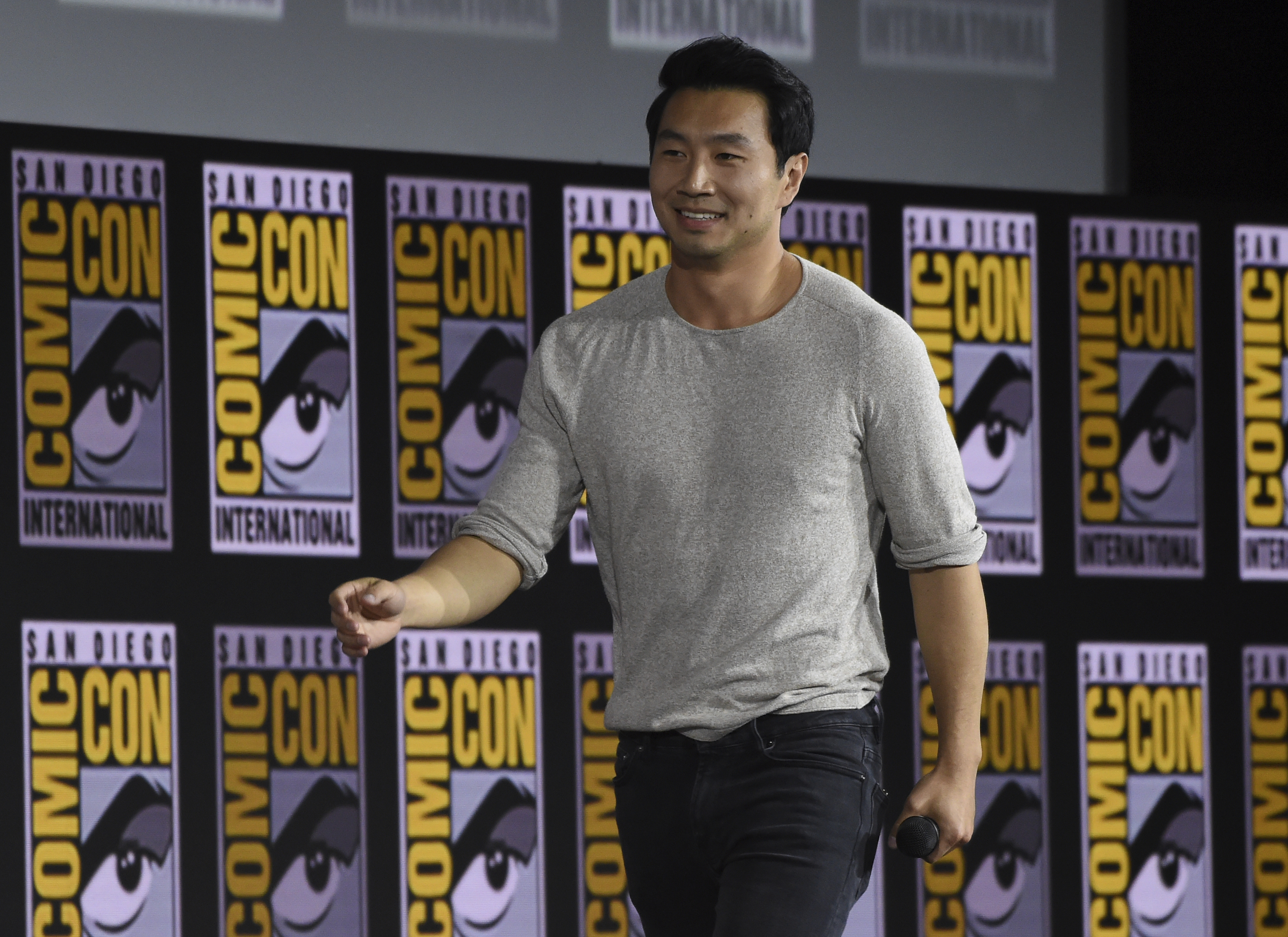 "Simu Liu walks on stage during the ""Shang-Chi and The Legend of the Ten Rings"" portion of the Marvel Studios panel on day three of Comic-Con International on Saturday, July 20, 2019, in San Diego. (Photo by Chris Pizzello/Invision/AP)"