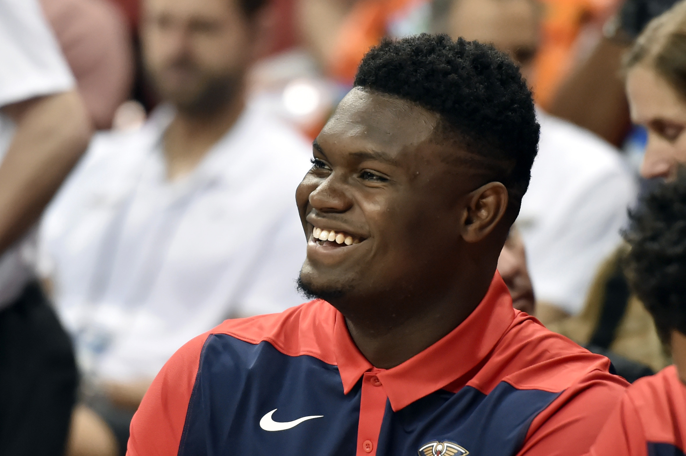 New Orleans Pelicans' Zion Williamson smiles while sitting on the bench during the first half of the team's NBA summer league basketball game against the Washington Wizards on Saturday, July 6, 2019, in Las Vegas. (AP Photo/David Becker)