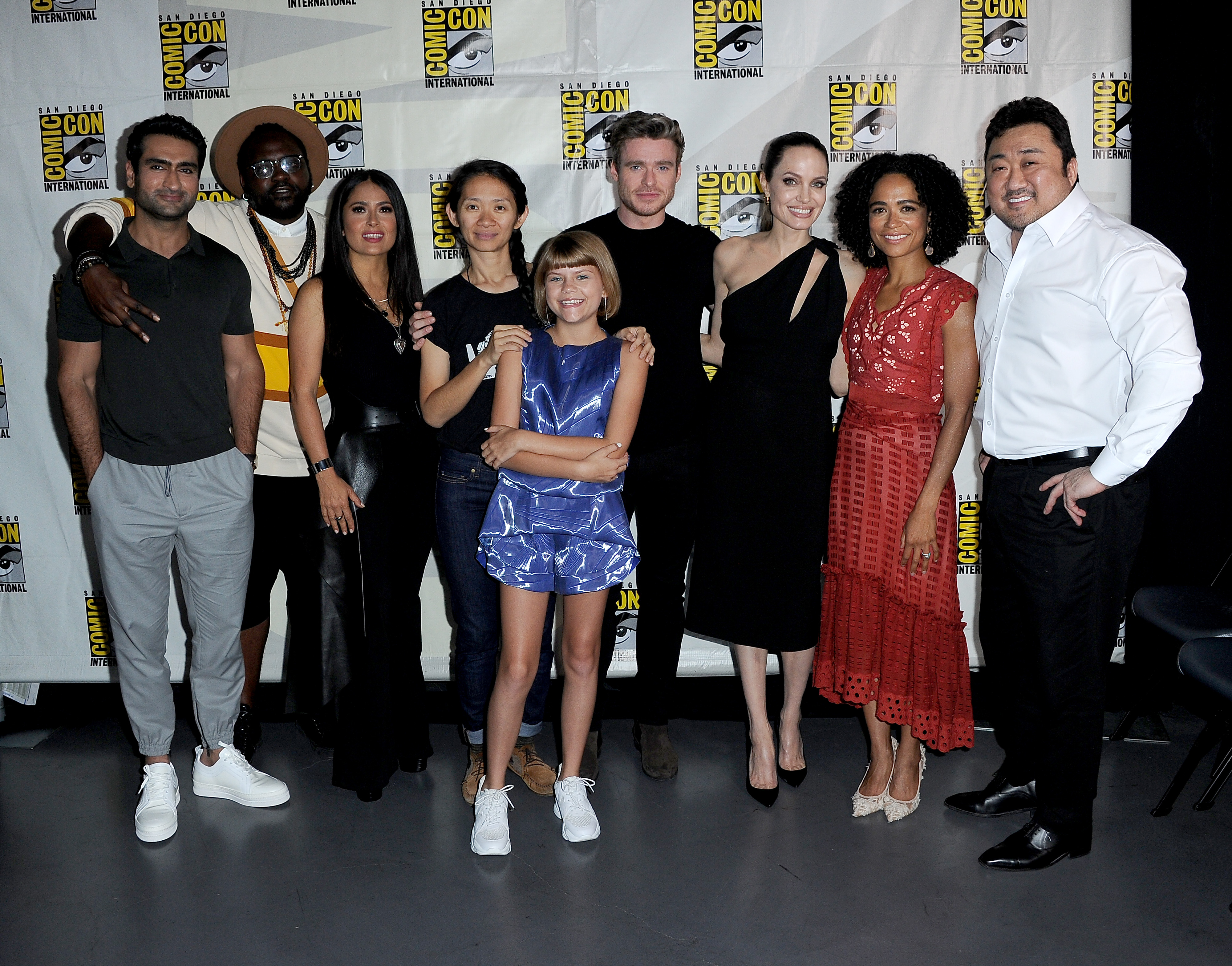 SAN DIEGO, CALIFORNIA - JULY 20: (L-R) Kumail Nanjiani, Brian Tyree Henry, Salma Hayek, Chloe Zhao, Lia McHugh, Richard Madden, Angelina Jolie, Lauren Ridloff and Dong-seok Ma attend the Marvel Studios Panel during 2019 Comic-Con International at San Diego Convention Center on July 20, 2019 in San Diego, California. (Photo by Albert L. Ortega/Getty Images)