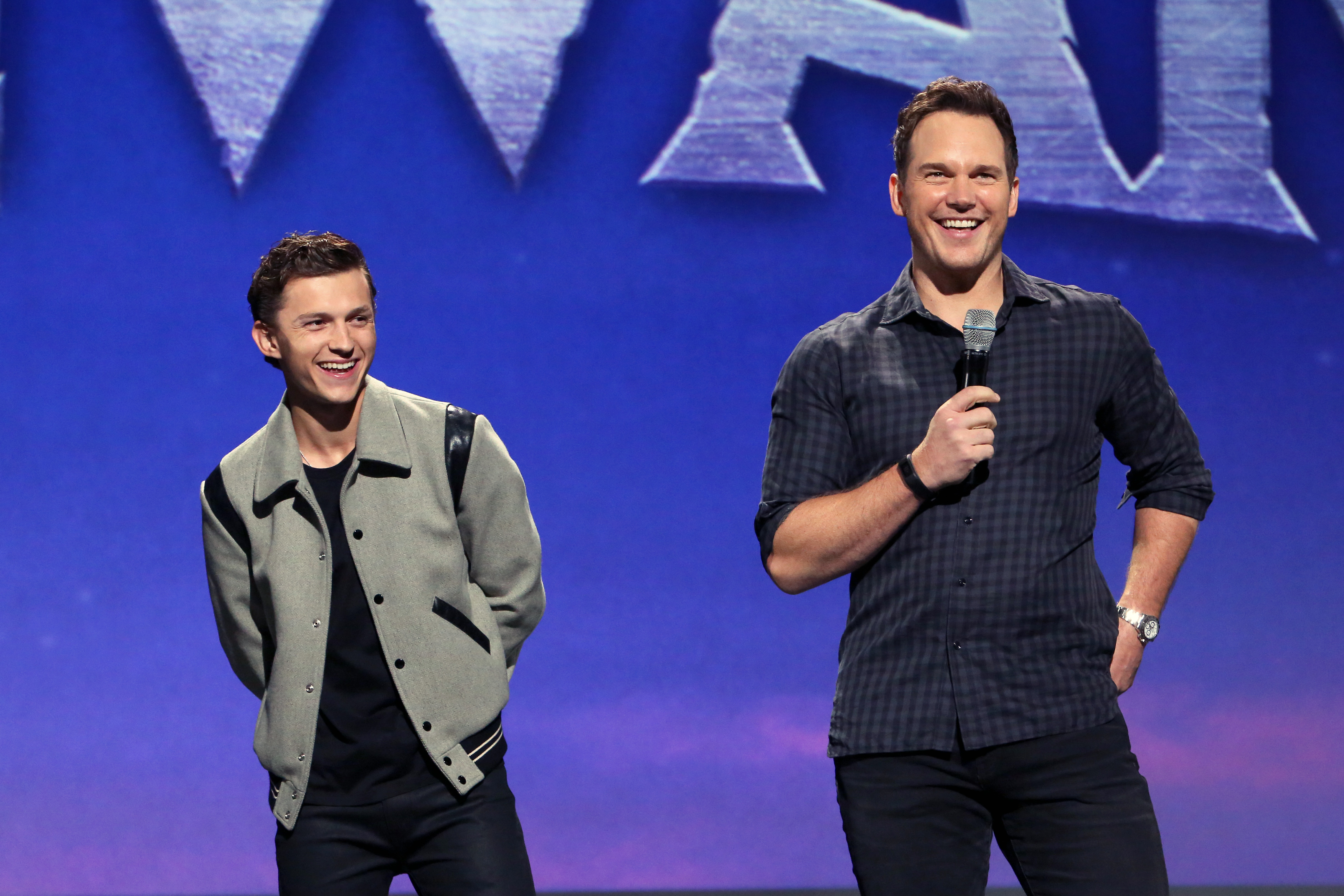 ANAHEIM, CALIFORNIA - AUGUST 24: (L-R) Tom Holland and Chris Pratt of 'Onward' took part today in the Walt Disney Studios presentation at Disney's D23 EXPO 2019 in Anaheim, Calif. 'Onward' will be released in U.S. theaters on March 6, 2020. (Photo by Jesse Grant/Getty Images for Disney)