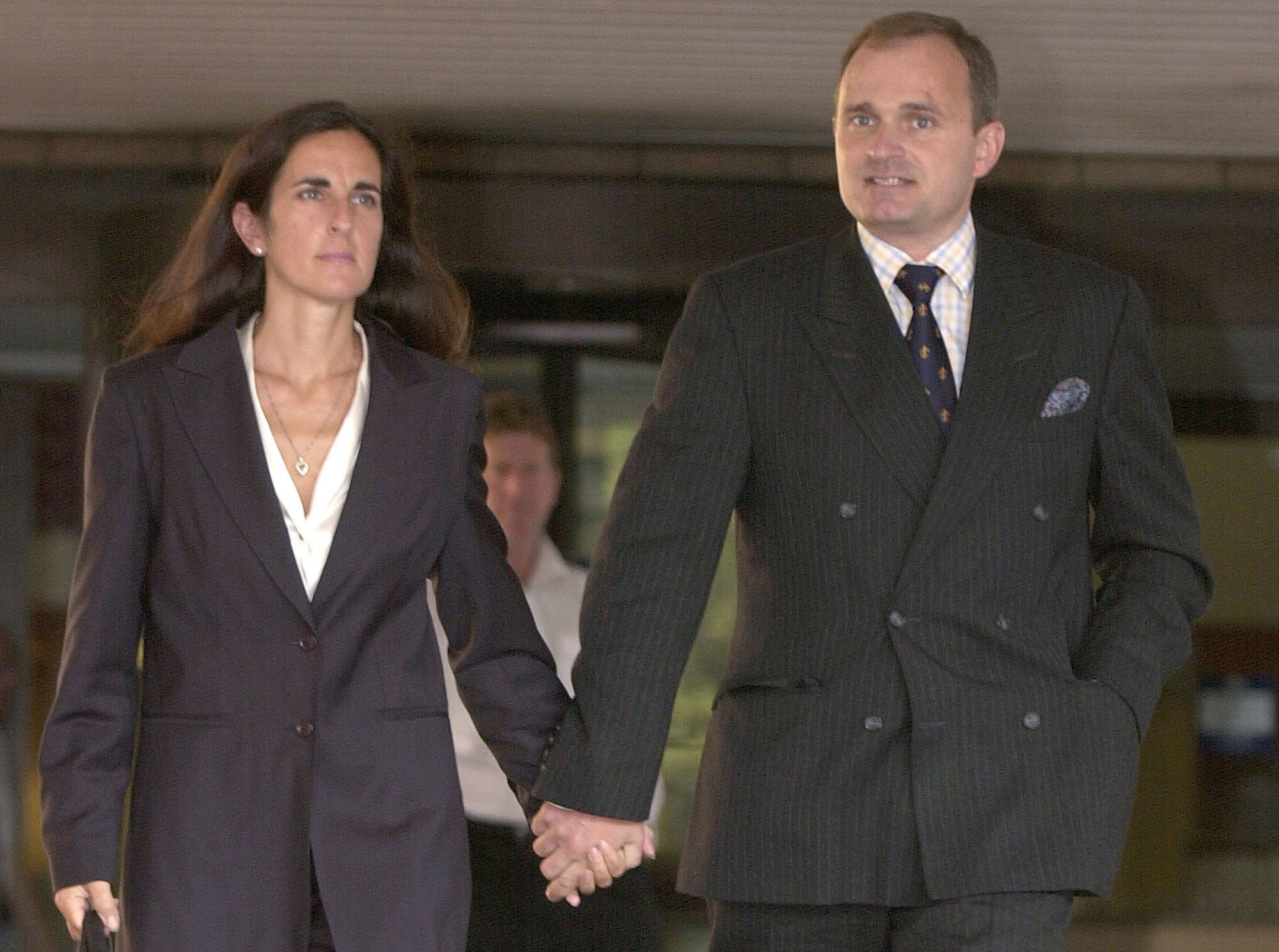 Charles Ingram and his wife Diana leave the Southwark Crown Court in southeast London Wednesday, Aug. 28, 2002. (AP Photo/Richard Lewis)