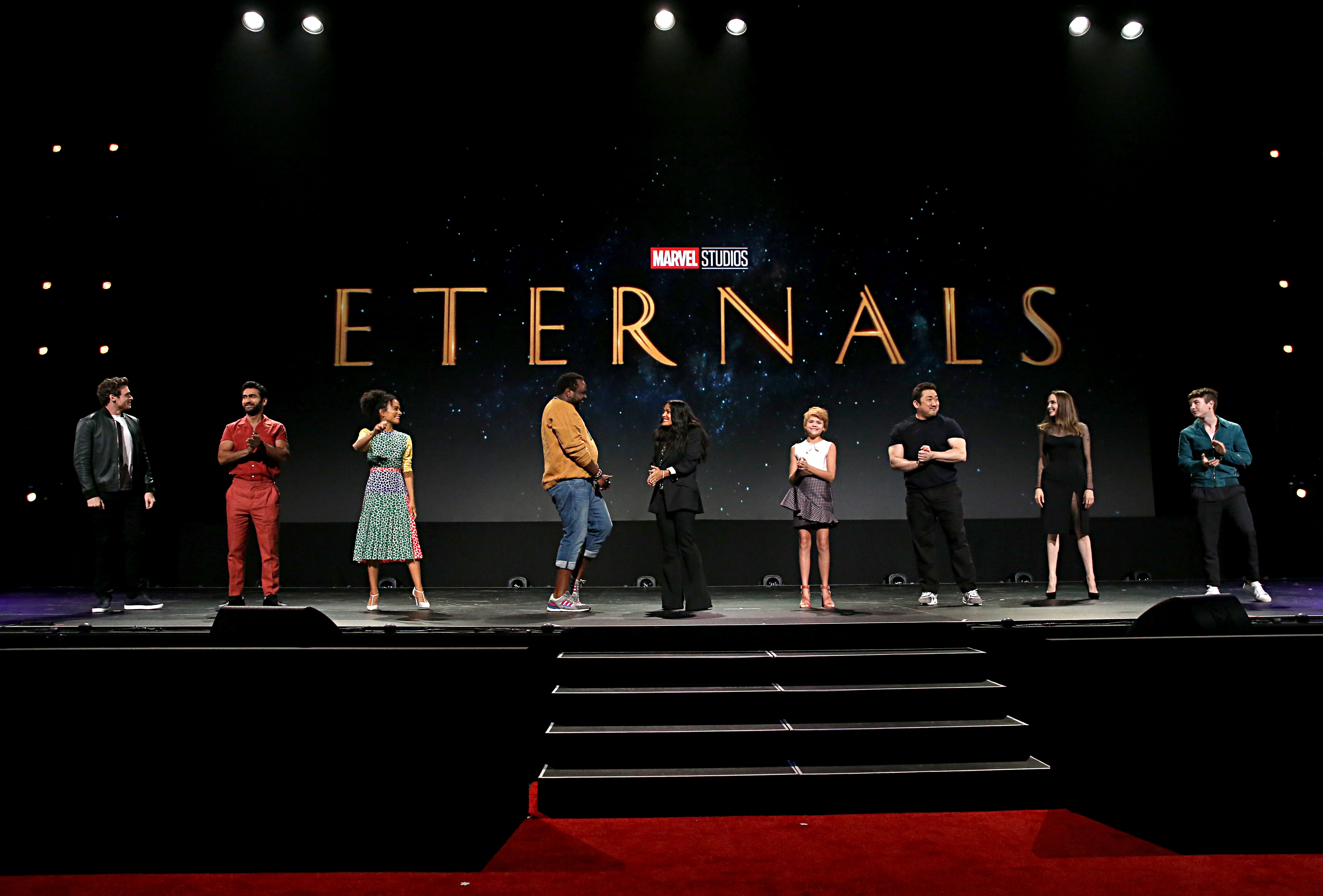 ANAHEIM, CALIFORNIA - AUGUST 24: (L-R) Richard Madden, Kumail Nanjiani, Lauren Ridloff, Salma Hayek, Lia McHugh, Don Lee, Angelina Jolie, and Barry Keoghan of 'The Eternals' took part today in the Walt Disney Studios presentation at Disney's D23 EXPO 2019 in Anaheim, Calif. 'The Eternals' will be released in U.S. theaters on November 6, 2020. (Photo by Jesse Grant/Getty Images for Disney)