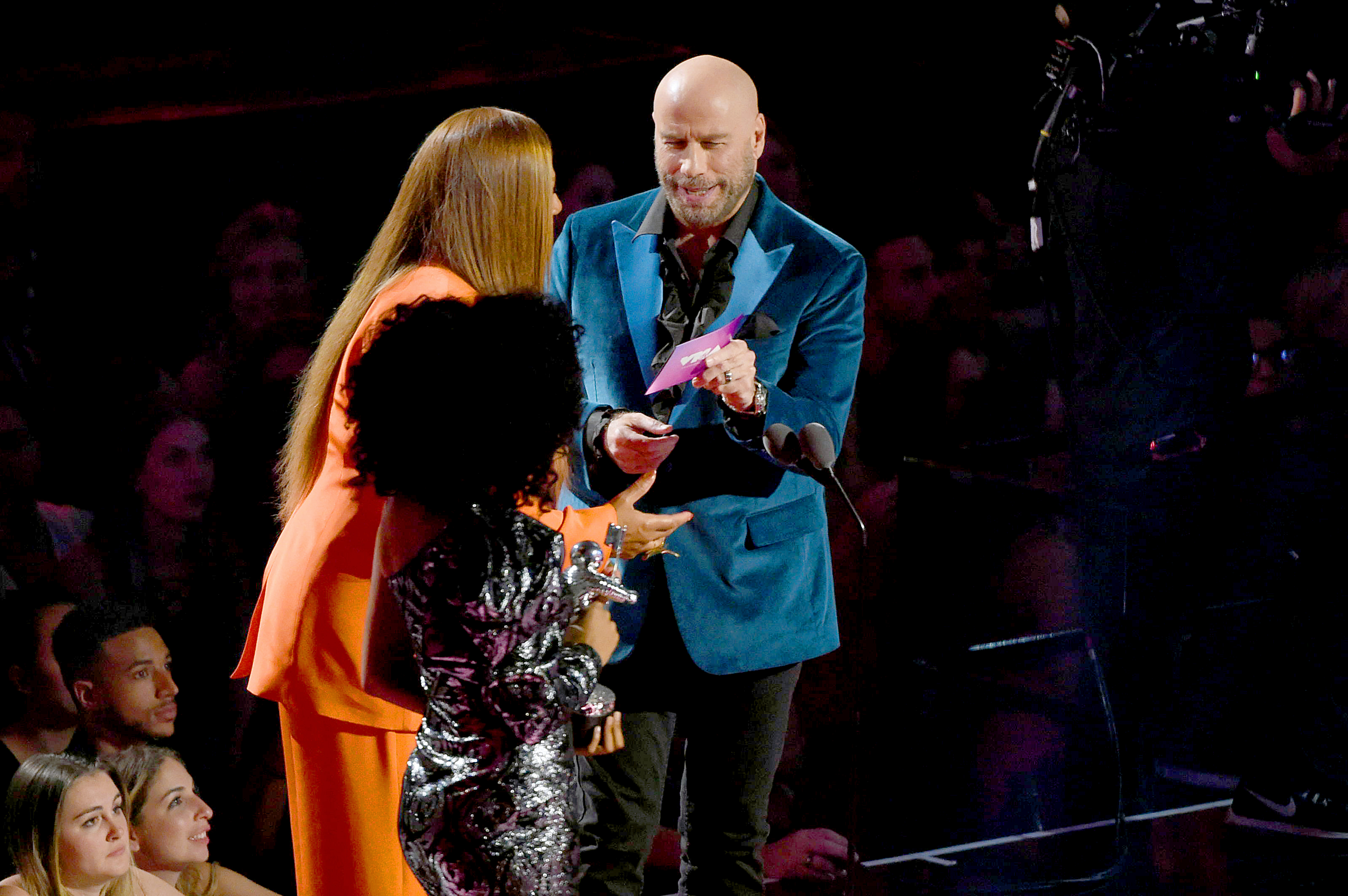 NEWARK, NEW JERSEY - AUGUST 26: Queen Latifah and John Travolta speak onstage during the 2019 MTV Video Music Awards at Prudential Center on August 26, 2019 in Newark, New Jersey. (Photo by Bryan Bedder/Getty Images,)
