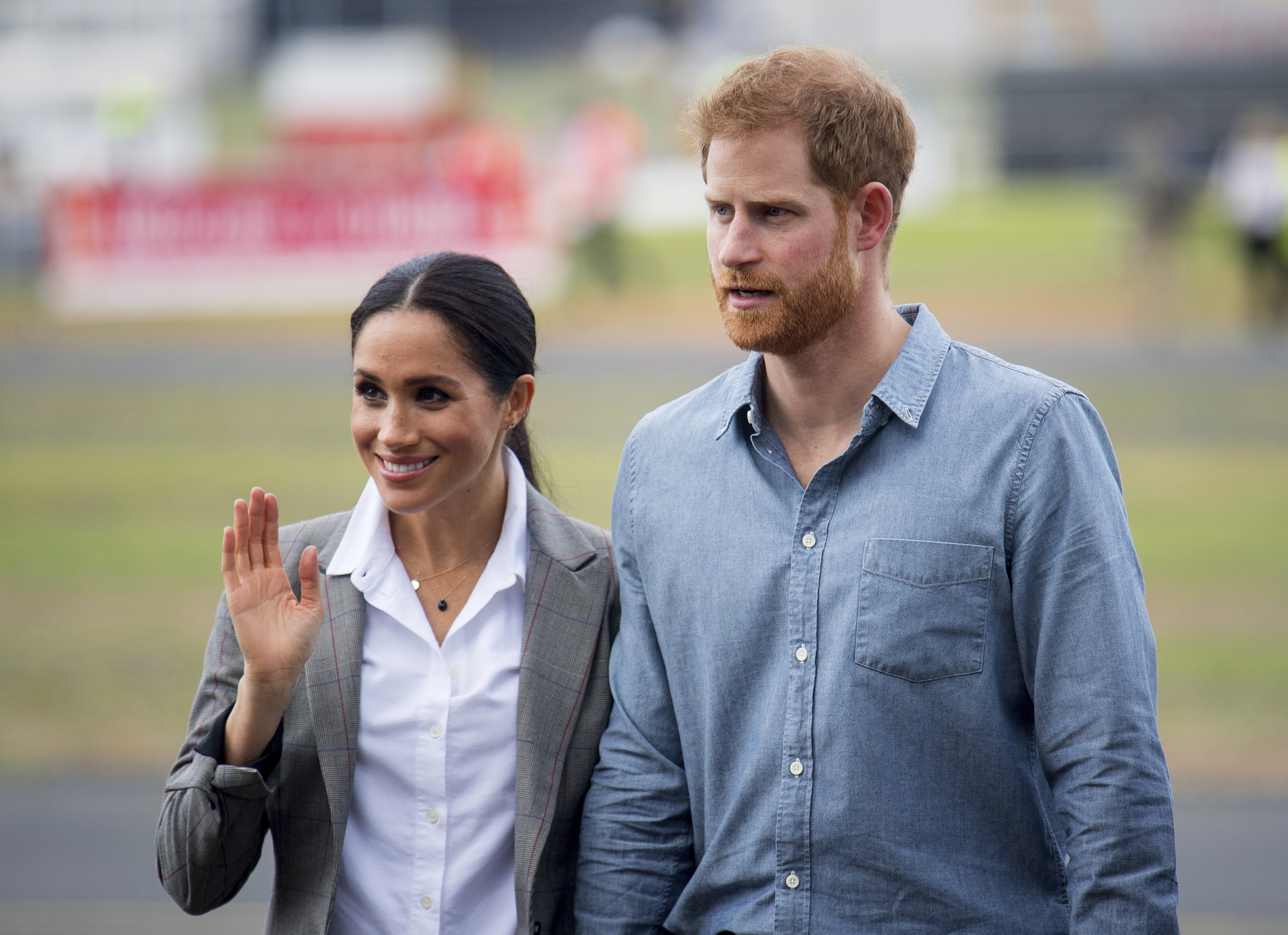 The Duke and Duchess of Sussex attend the naming and unveiling of a new Royal Flying Doctor Service aircraft at Dubbo City Regional Airport, in Dubbo, Australia, Wednesday, Oct. 17, 2018. Prince Harry and his wife Meghan are on day two of their 16-day tour of Australia and the South Pacific. (Dominic Lipinski/Pool via AP)