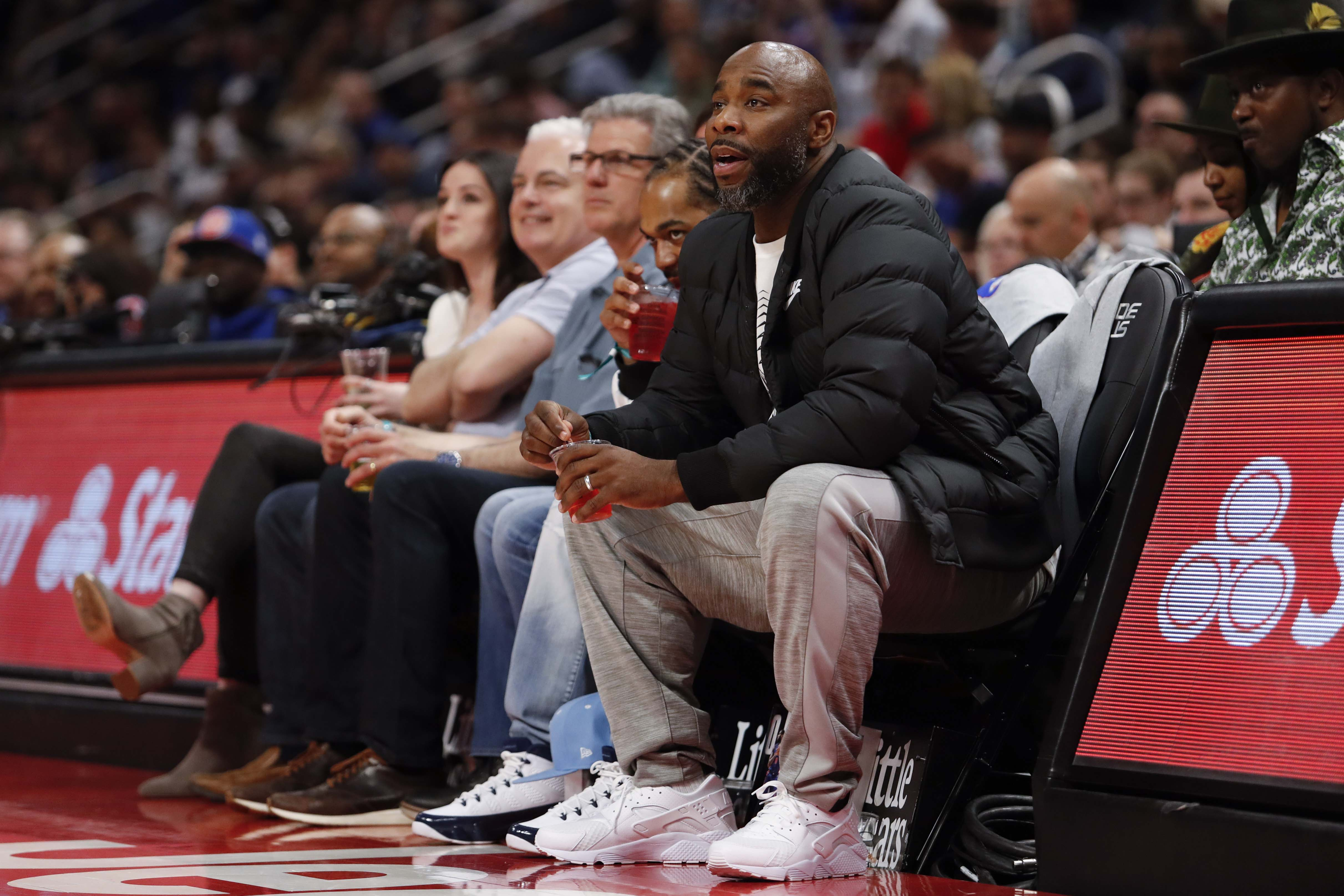 Apr 7, 2019; Detroit, MI, USA; Former professional basketball player Mateen Cleaves sits in the front row during the third quarter in the game between the Detroit Pistons and the Charlotte Hornets at Little Caesars Arena. Mandatory Credit: Raj Mehta-USA TODAY Sports