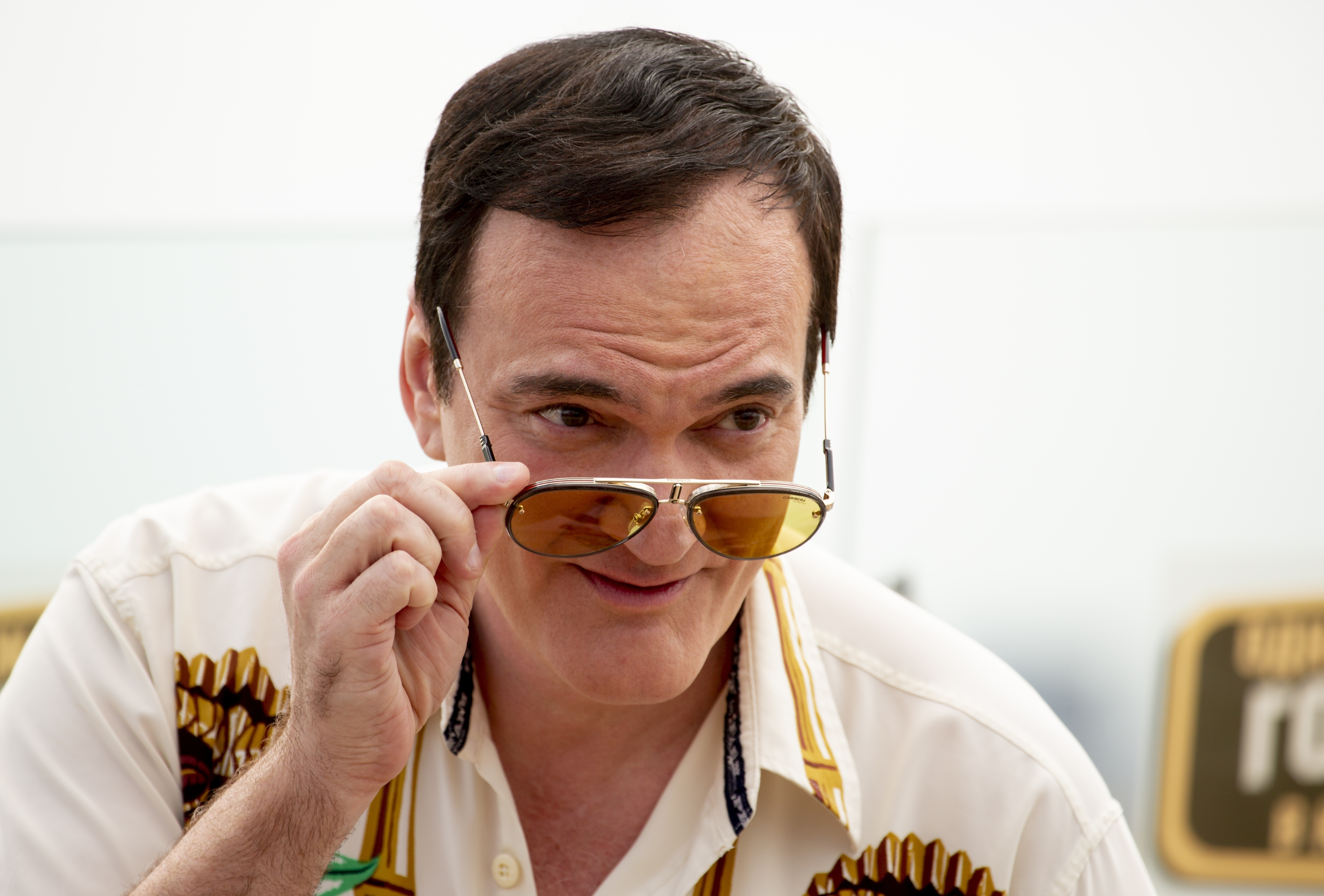 American writer and film director Quentin Tarantino pose for photographers prior to the premiere of the movie 'Once Upon A Time in Hollywood' in Moscow, Russia, Wednesday, Aug. 7, 2019. (AP Photo/Alexander Zemlianichenko)