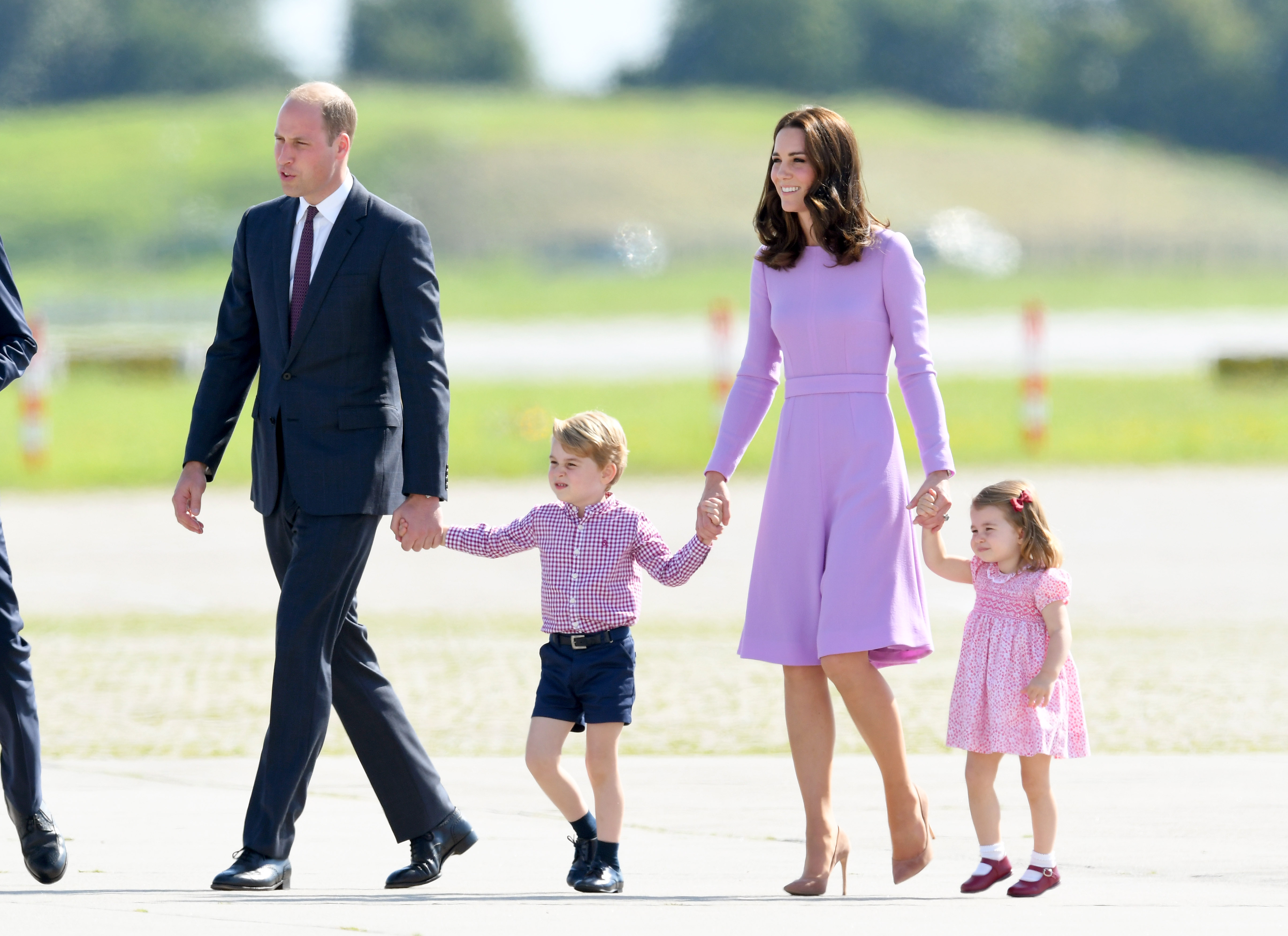 HAMBURG, GERMANY - JULY 21:  Prince William, Duke of Cambridge, Prince George, Princess Charlotte of Cambridge and Catherine, Duchess of Cambridge view helicopter models H145 and H135 before departing from Hamburg airport on the last day of their official visit to Poland and Germany on July 21, 2017 in Hamburg, Germany.  (Photo by Karwai Tang/WireImage)