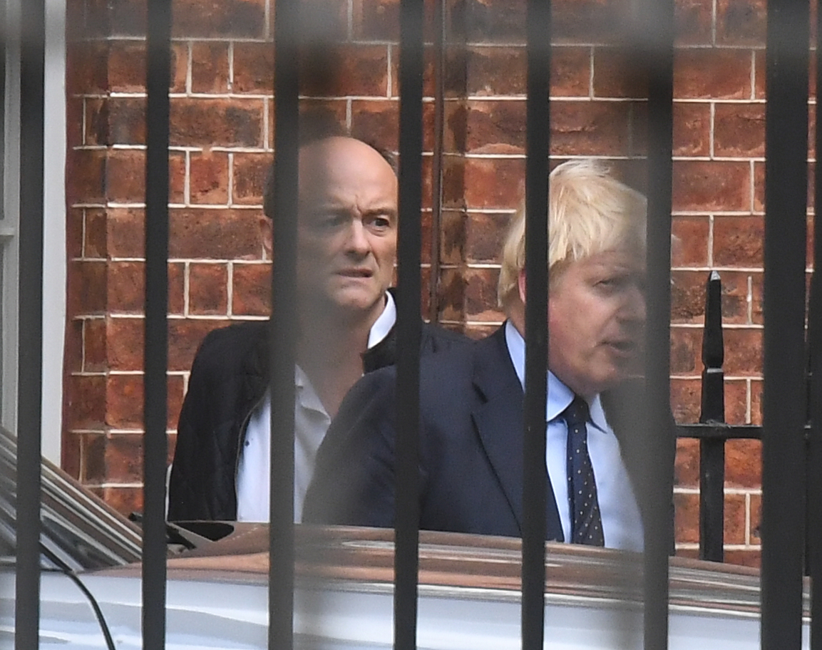 Prime Minister Boris Johnson with his senior aid Dominic Cummings as they leave Downing Street, central London.