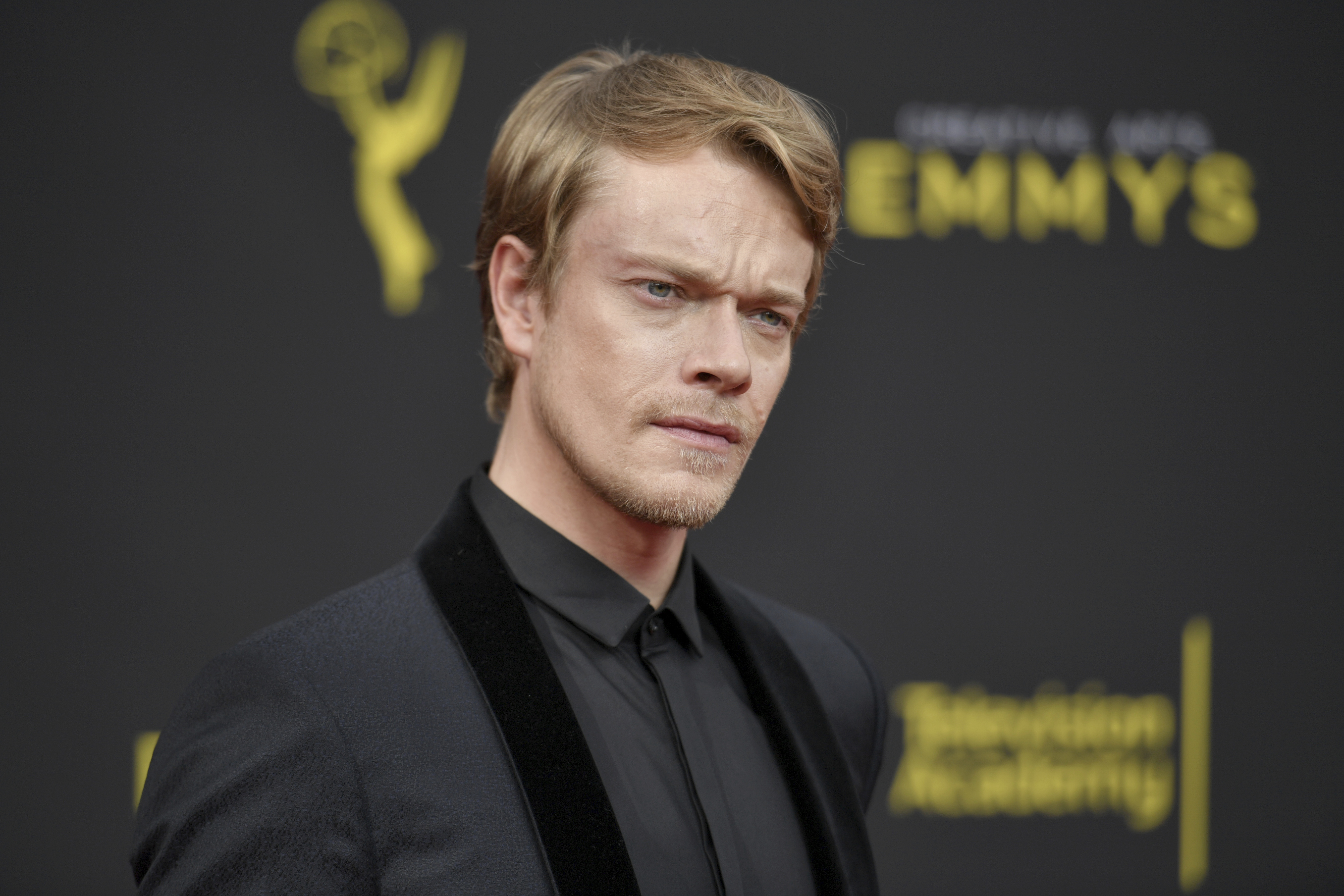 Alfie Allen arrives at night two of the Creative Arts Emmy Awards on Sunday, Sept. 15, 2019, at the Microsoft Theater in Los Angeles. (Photo by Richard Shotwell/Invision/AP)