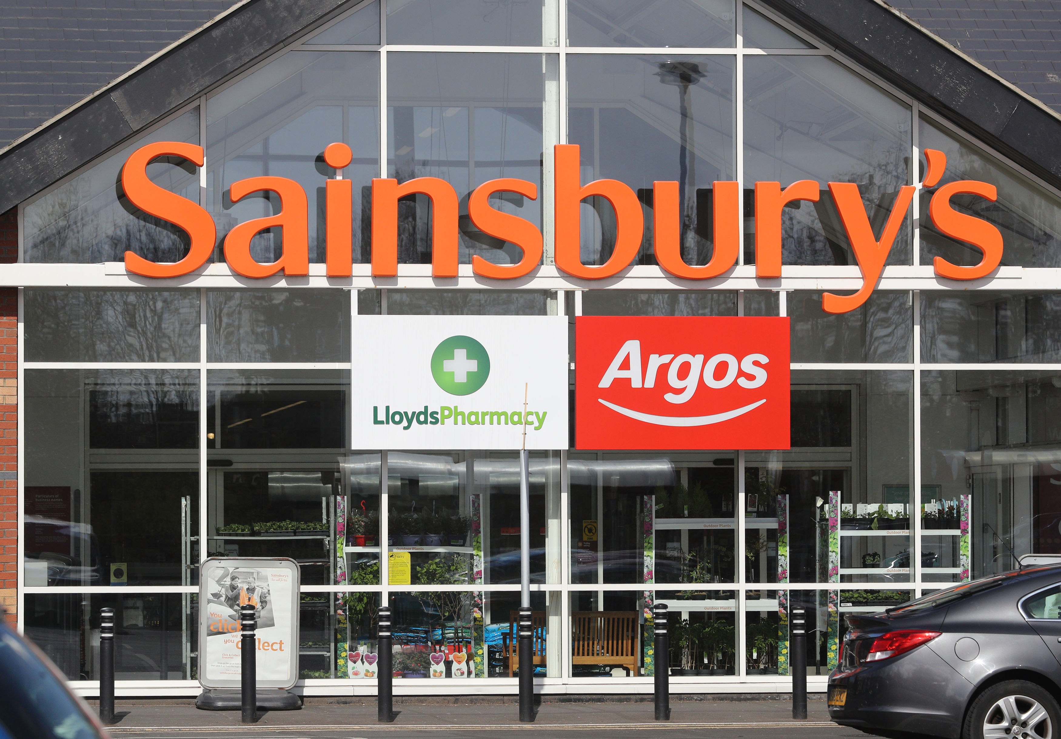 General view of the entrance to a Sainsbury's supermarket, incorporating a Lloyds Pharmacy and an Argos store, in Whitley Bay, North Tyneside.