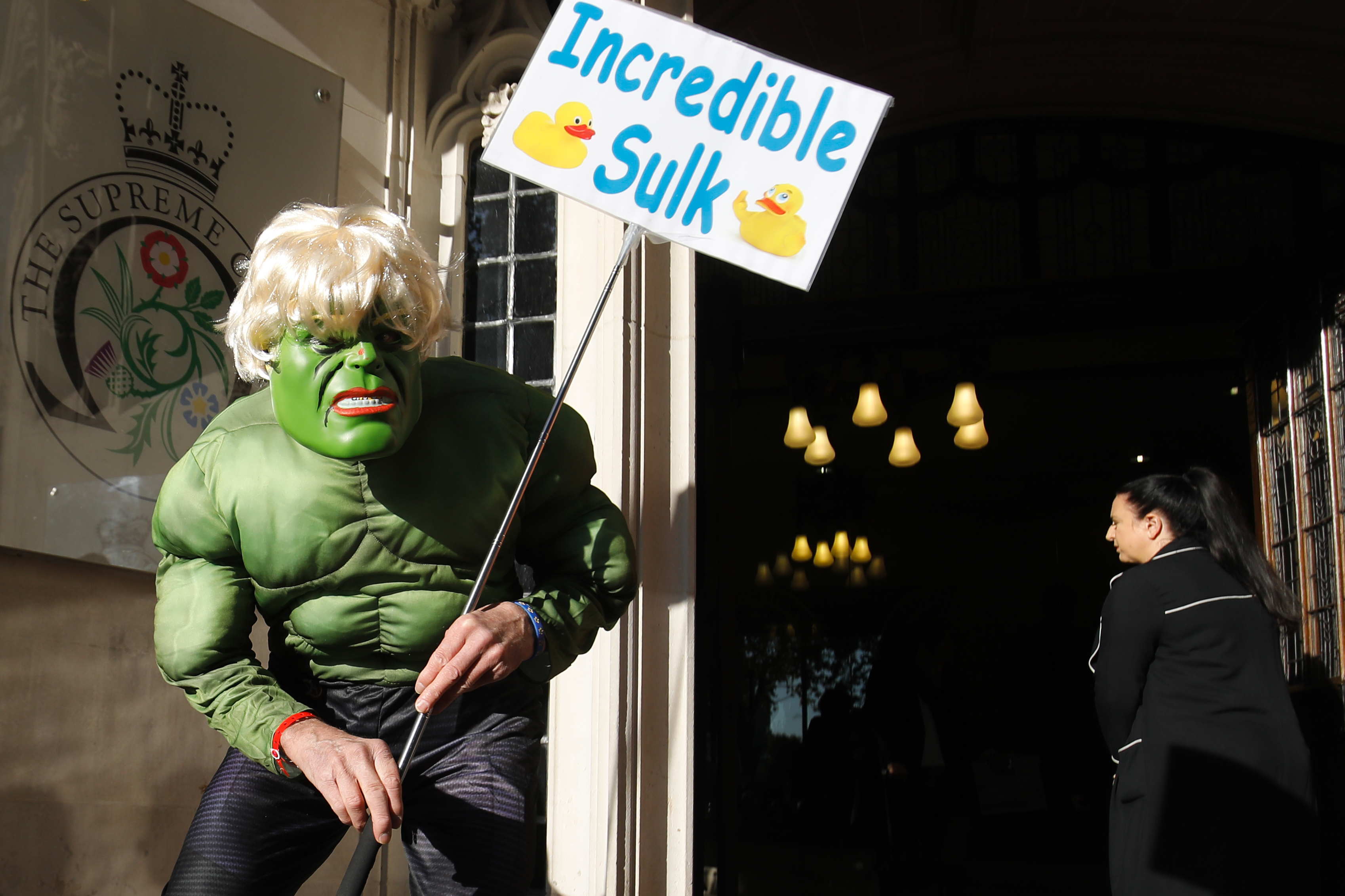 A protestor dressed as a cross between Boris Johnson and the Incredible Hulk outside the Supreme Court