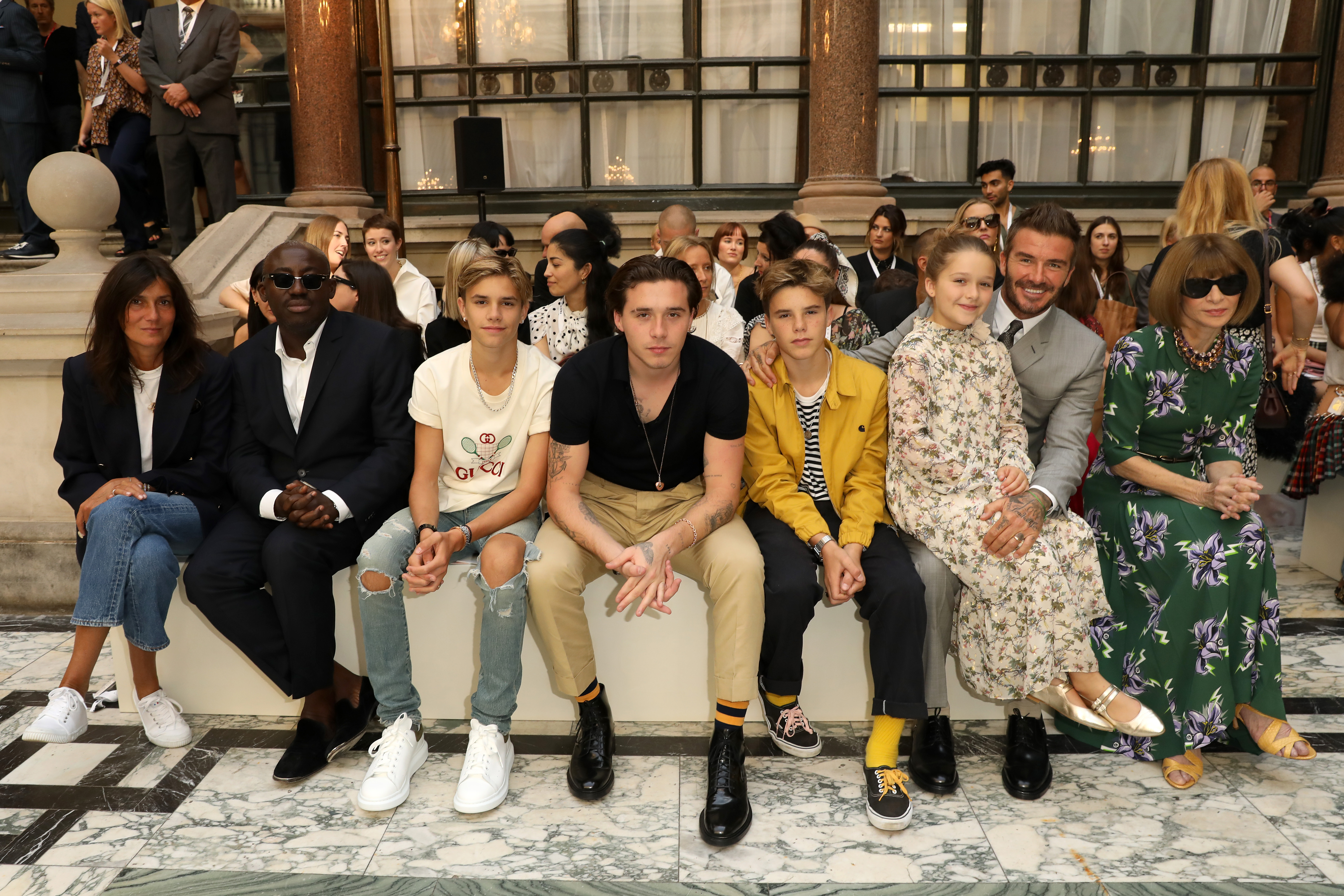 LONDON, ENGLAND - SEPTEMBER 15: (L-R) Emmanuelle Alt, Edward Enninful, Romeo Beckham, Brooklyn Beckham, Cruz Beckham, Harper Beckham, David Beckham and Anna Wintour attend the Victoria Beckham show during London Fashion Week September 2019 at British Foreign and Commonwealth Office on September 15, 2019 in London, England. (Photo by Darren Gerrish/WireImage)