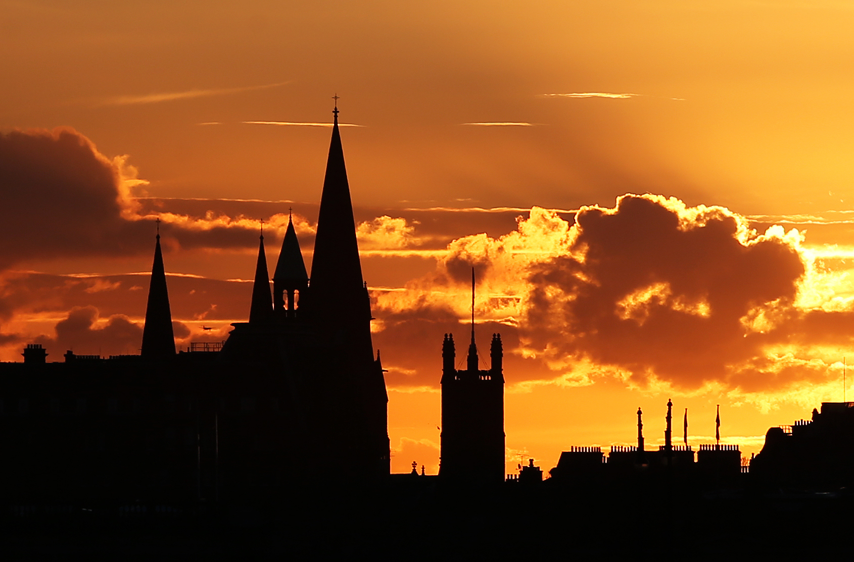 The sun sets over the Edinburgh skyline. (Photo by Jane Barlow/PA Images via Getty Images)
