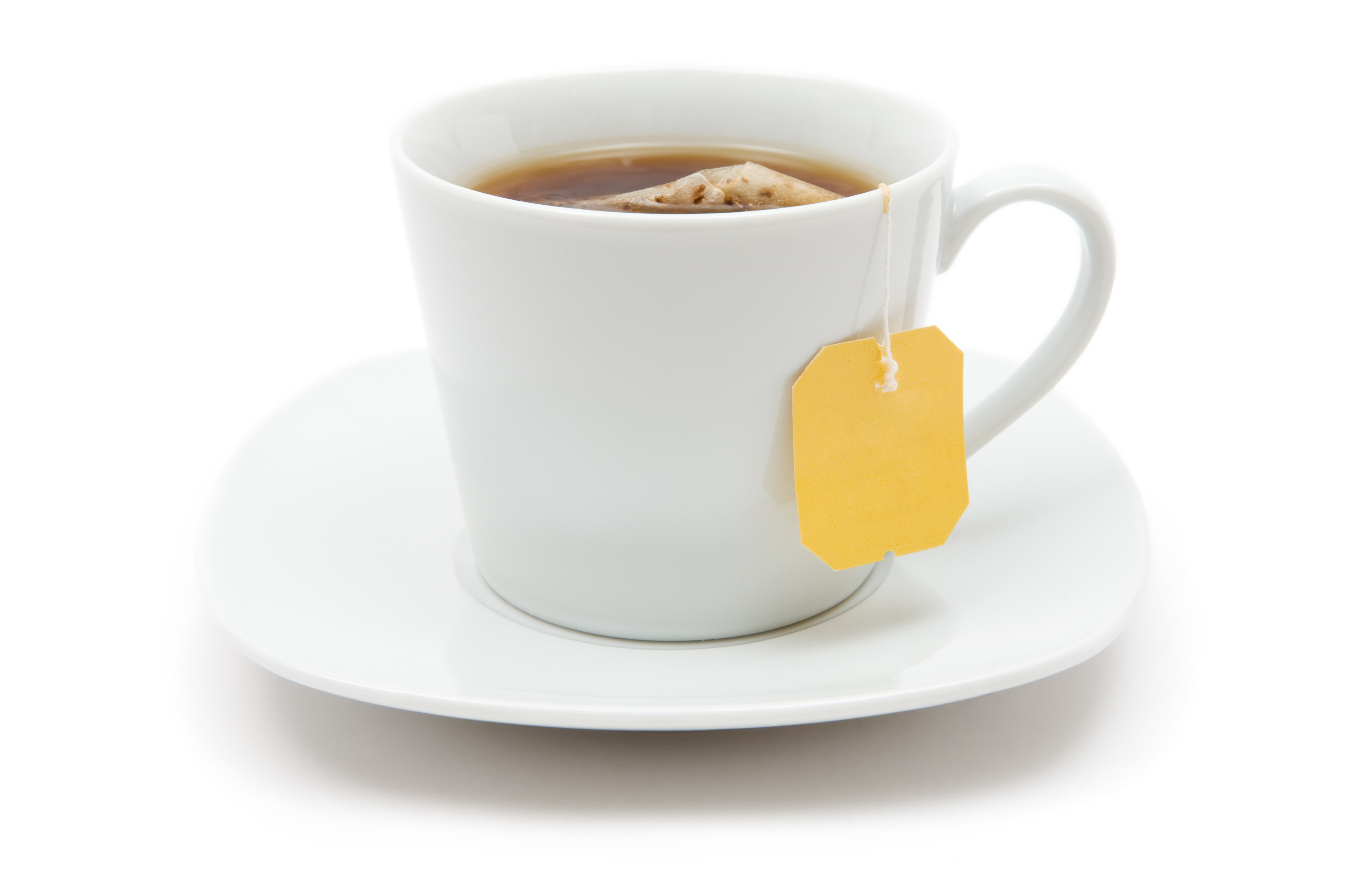 Full cup of black tea. White background.