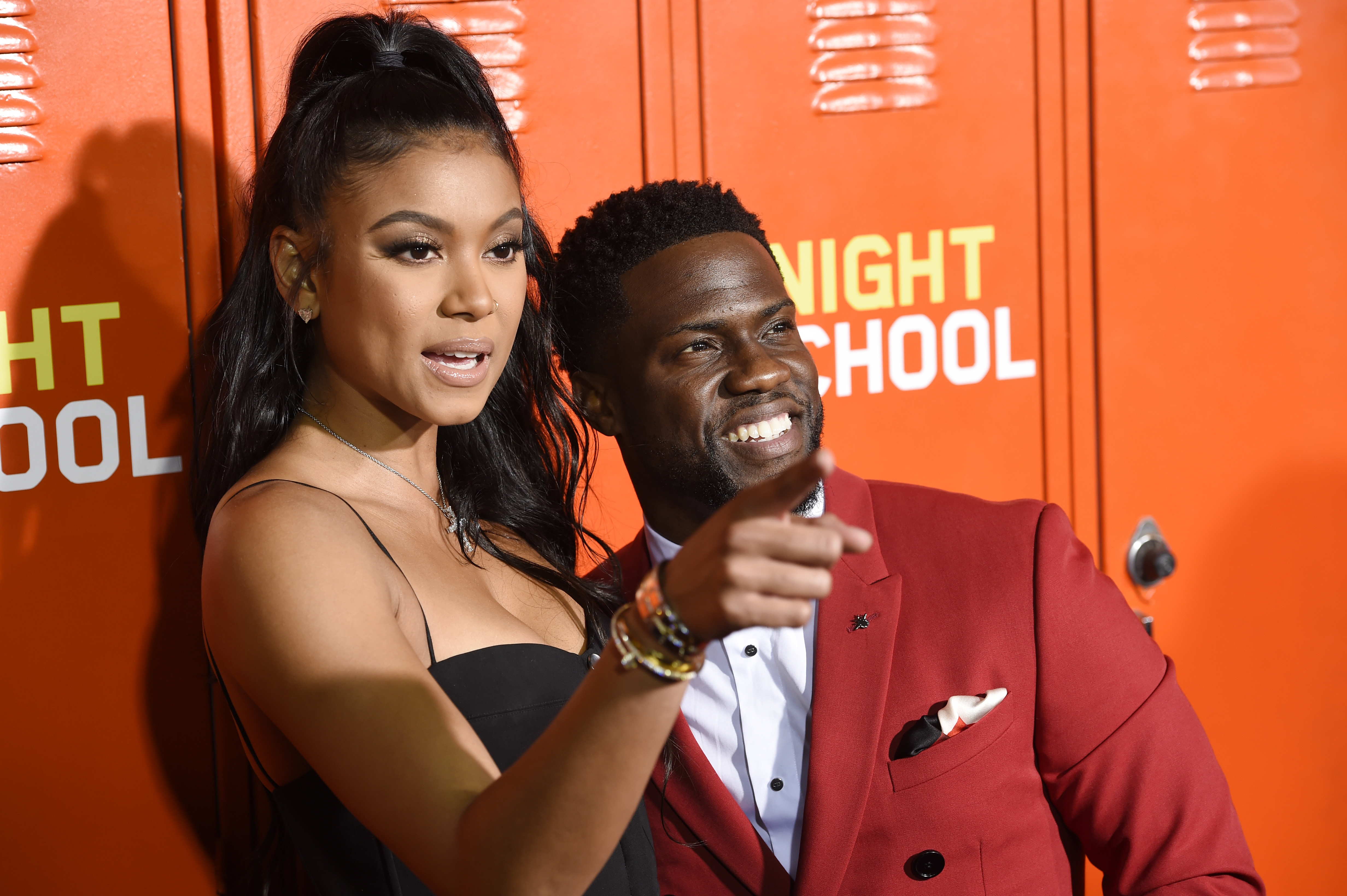 """Kevin Hart, right, a cast member, producer and co-writer of """"Night School,"""" poses with his wife Eniko Parrish at the premiere of the film, Monday, Sept. 24, 2018, in Los Angeles. (Photo by Chris Pizzello/Invision/AP)"""