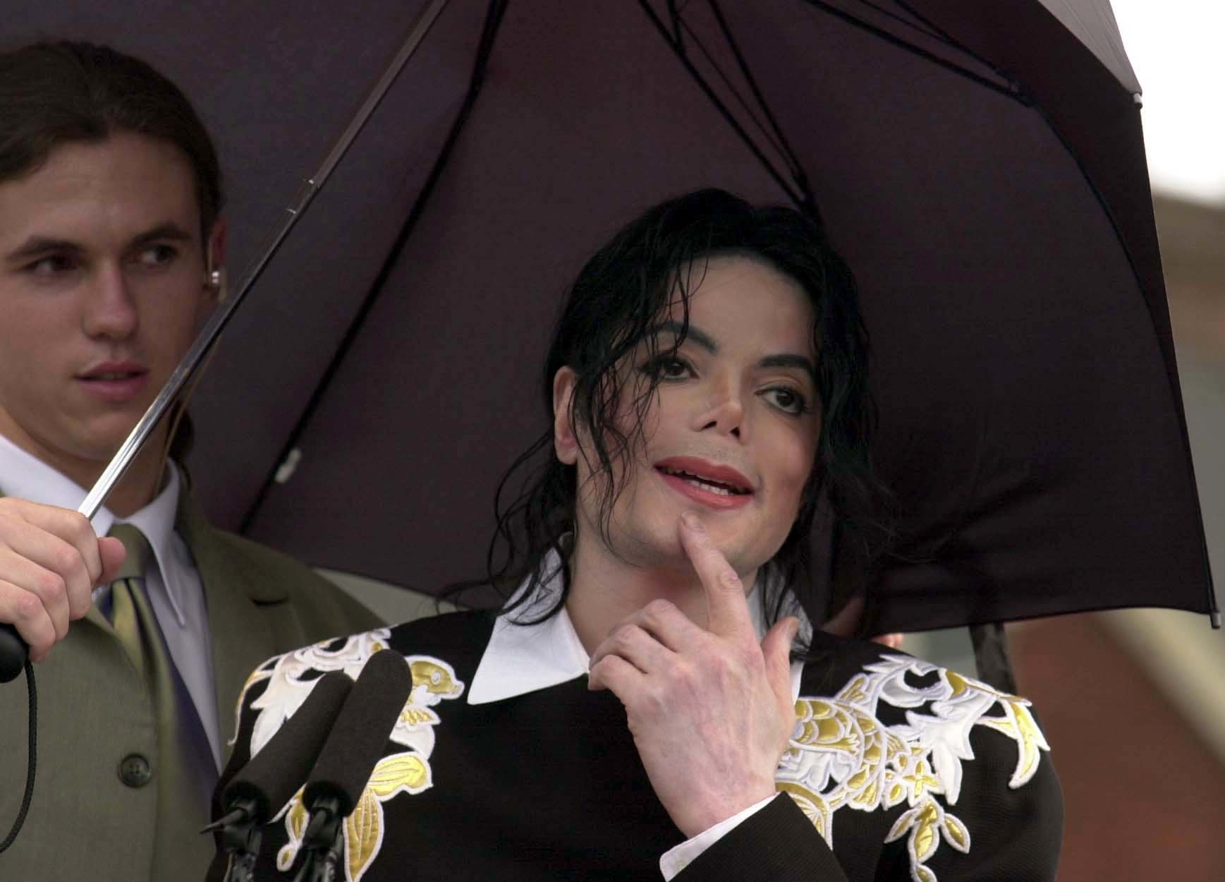 Pop legend Michael Jackson attends a fundraising event in aid of Children with Aids and Support for Africa at Exeter Football Club at St James Park, Exeter in Devon.  *15/06/02 Michael Jackson. Pop legend Michael Jackson has backed England's football team to beat Denmark in today's, Saturday 15th June 2002, crucial second round World Cup match. The vote of confidence came as the singer maintained his oddball reputation by making an appearance at the ground of a third division soccer club.