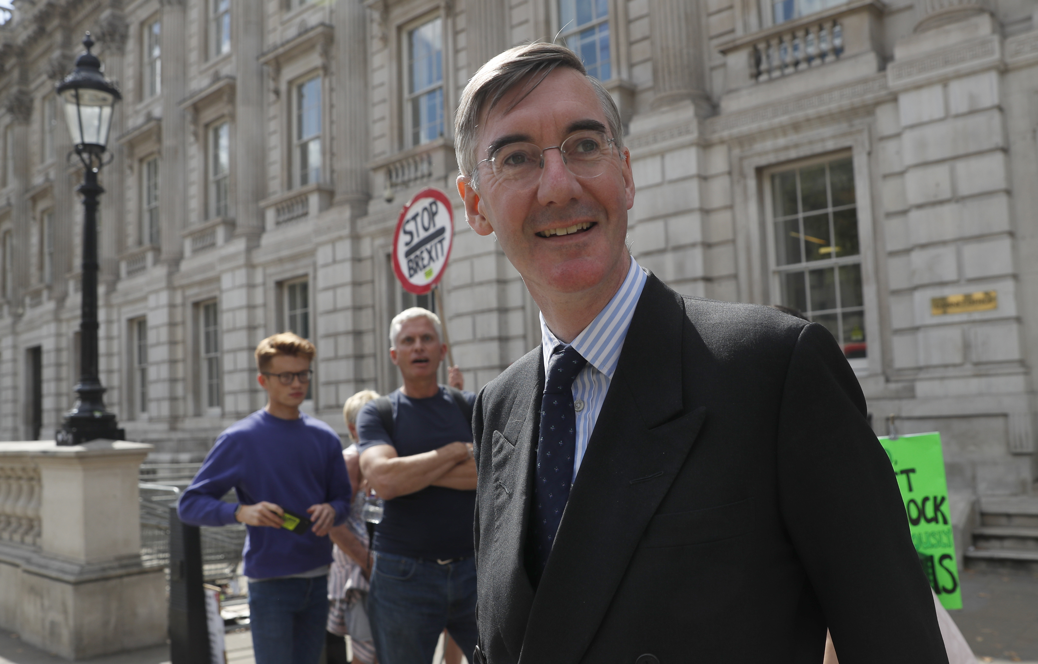 British lawmaker Jacob Rees-Mogg, Leader of the House of Commons, leaves the Cabinet Office in London, Monday, Sept. 2, 2019. Political opposition to Prime Minister Boris Johnson's move to suspend Parliament is crystalizing, with protests around Britain and a petition to block the move gaining more than 1 million signatures. (AP Photo/Alastair Grant)