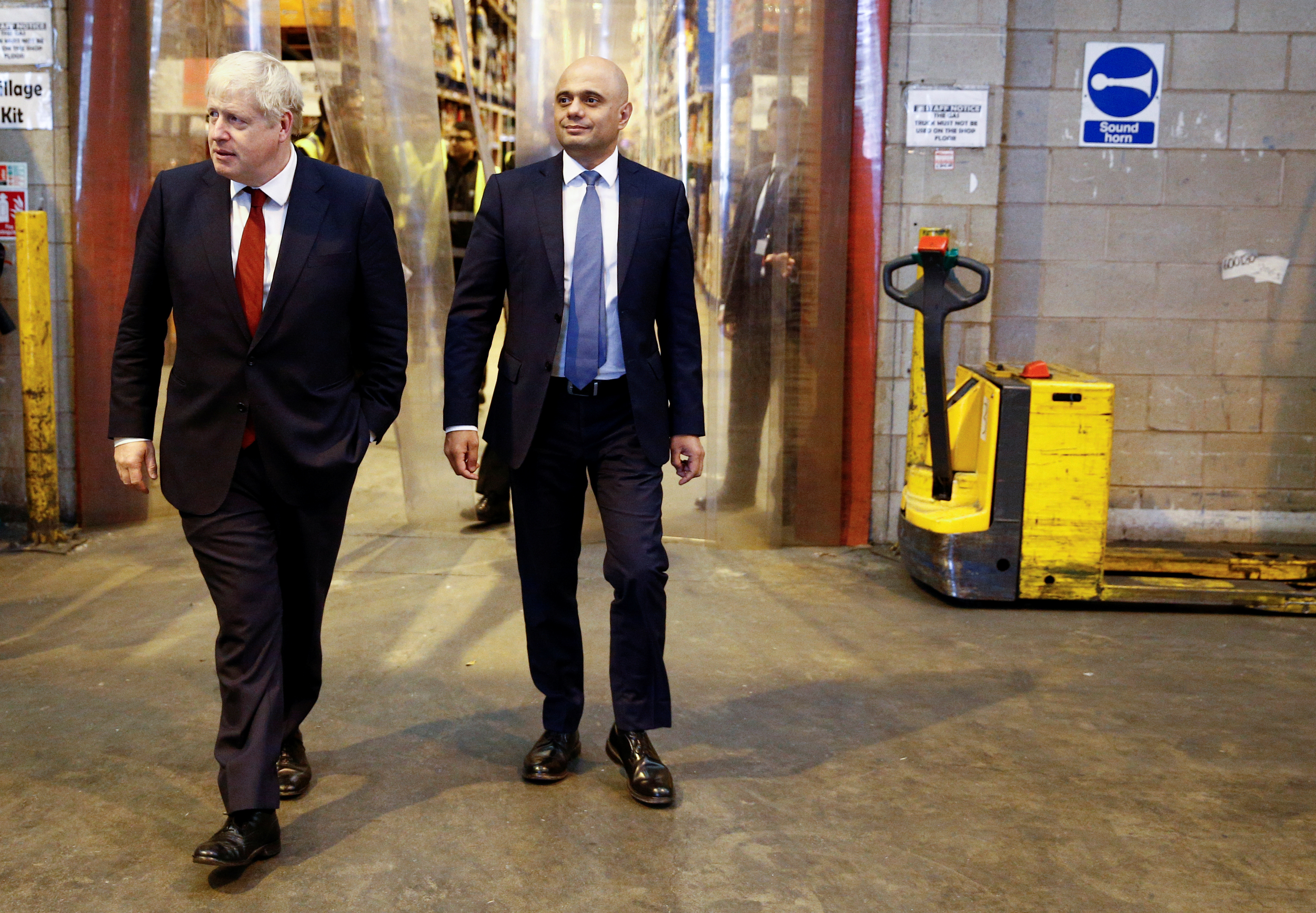 Prime Minister Boris Johnson (left) and the Chancellor of the Exchequer Sajid Javid during a visit to Bestway Wholesale in Manchester.