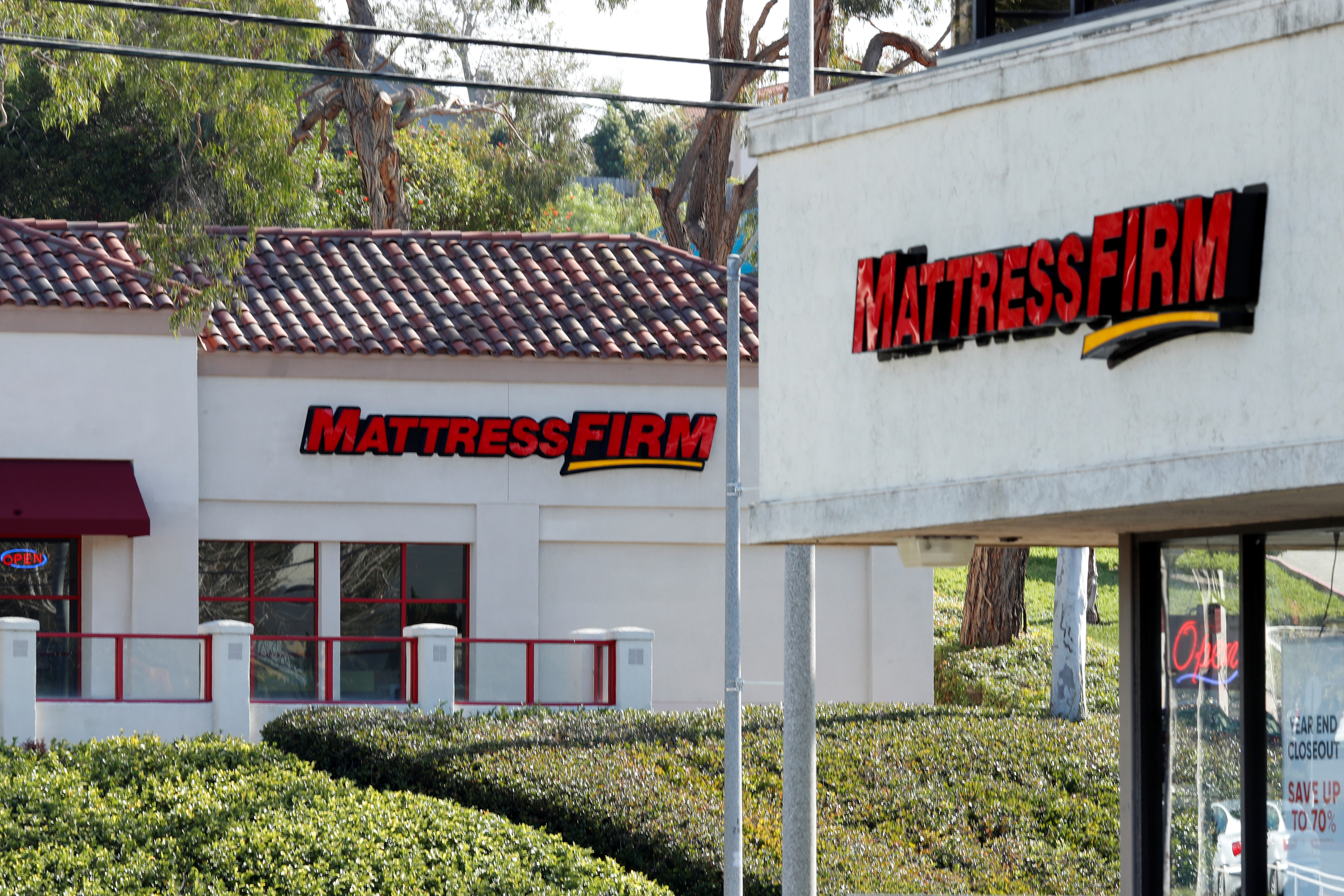 Two Mattress Firm stores, a brand owned by Steinhoff, lie on either side of the street in Encinitas, California, U.S., January 25, 2018.    REUTERS/Mike Blake