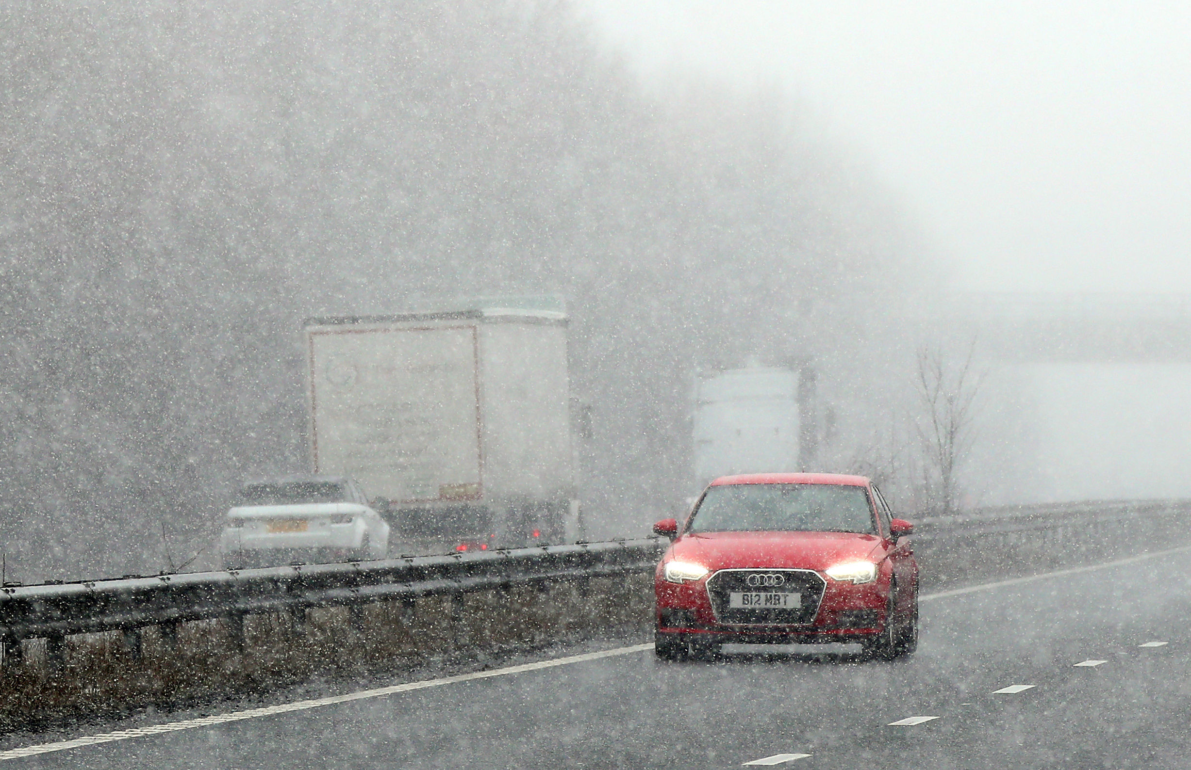 "Drivers face snowy conditions on the A2 near Canterbury in Kent as the cold snap dubbed the ""mini beast from the east"" continues across the UK."