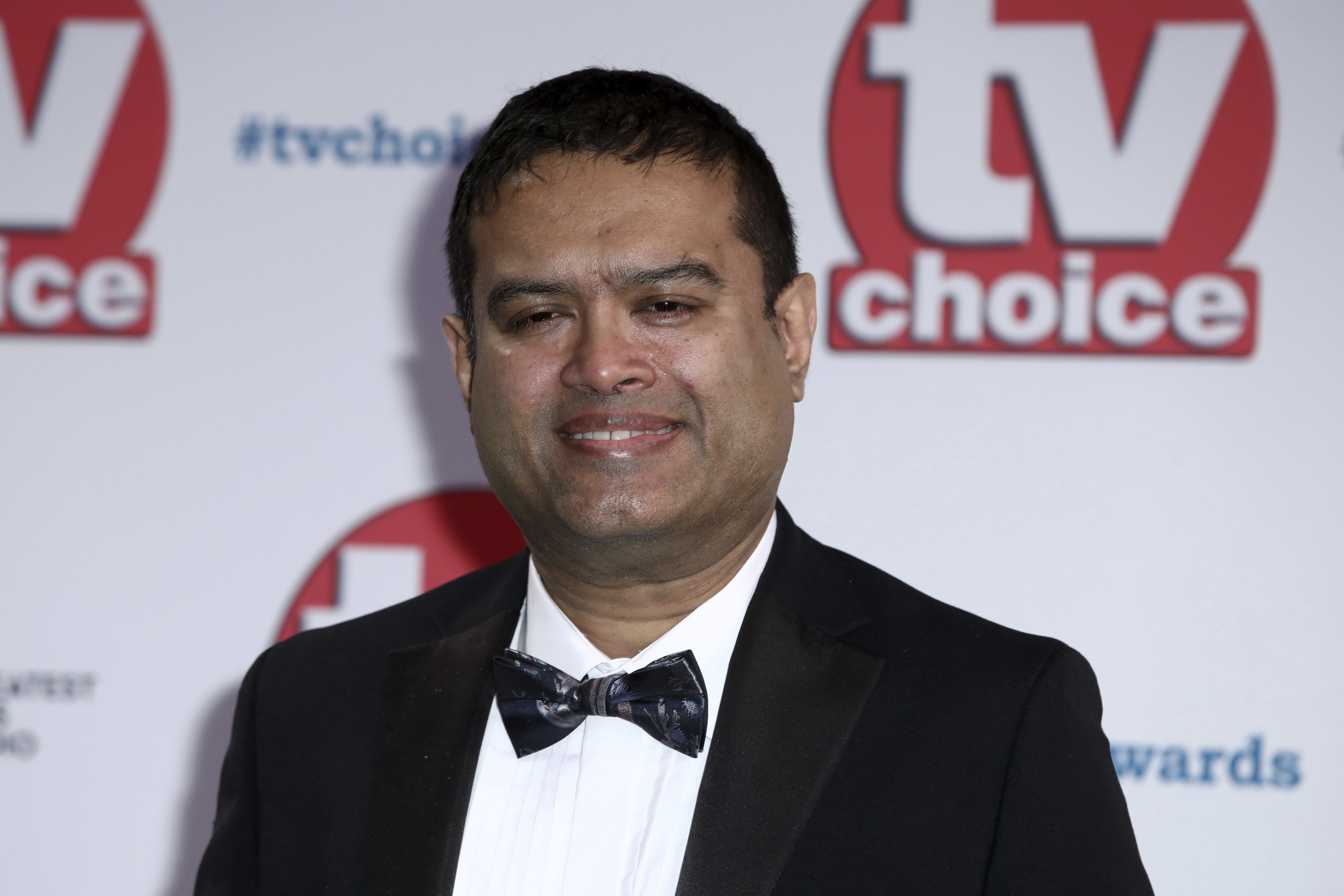 TV personality Paul Sinha poses for photographers on arrival at the TV Choice Awards in central London on Monday, Sept. 9, 2019. (Photo by Grant Pollard/Invision/AP)
