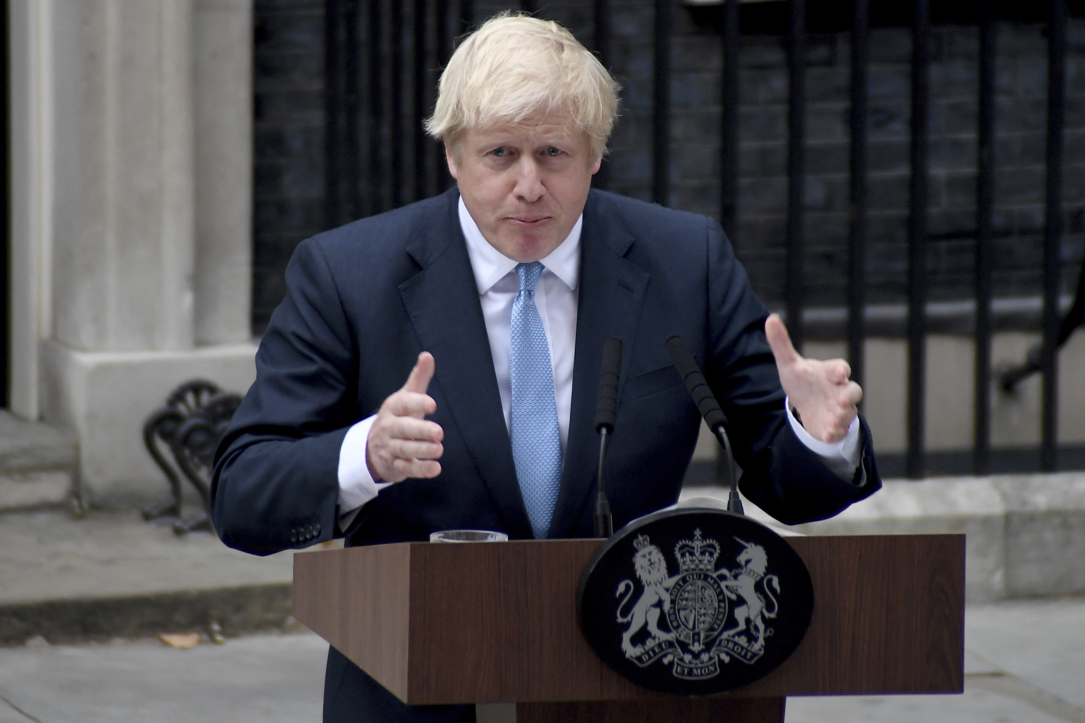 Britain's Prime Minister Boris Johnson speaks to the media outside 10 Downing Street in London, Monday, Sept. 2, 2019. Johnson says he doesn't want an election amid the Brexit crisis and issued a rallying cry to lawmakers to back him in securing a Brexit deal. (AP Photo/Alberto Pezzali)