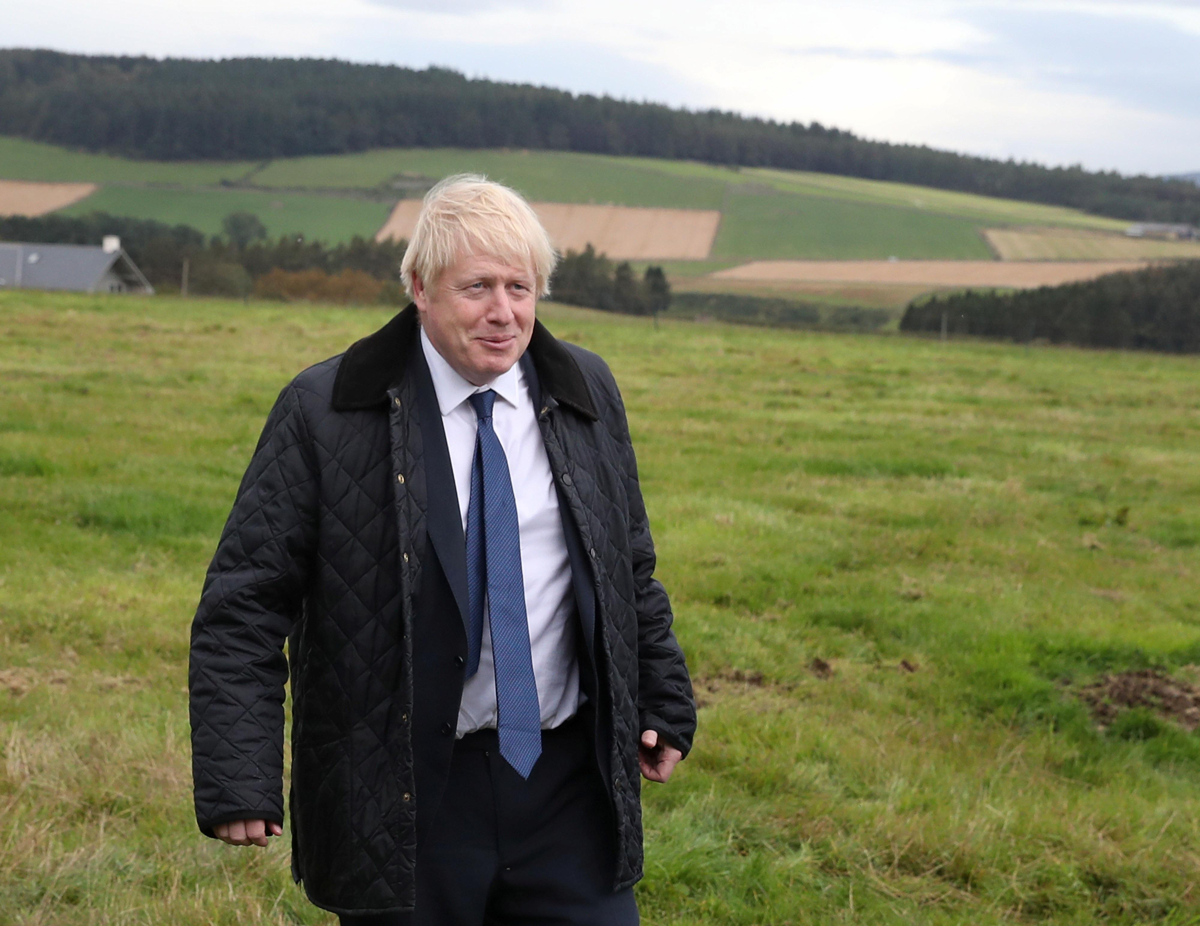 Britain's Prime Minister Boris Johnson visits Darnford Farm in Darnford, Banchory near Aberdeen, Scotland, Britain September 6, 2019. Andrew Milligan/Pool via REUTERS