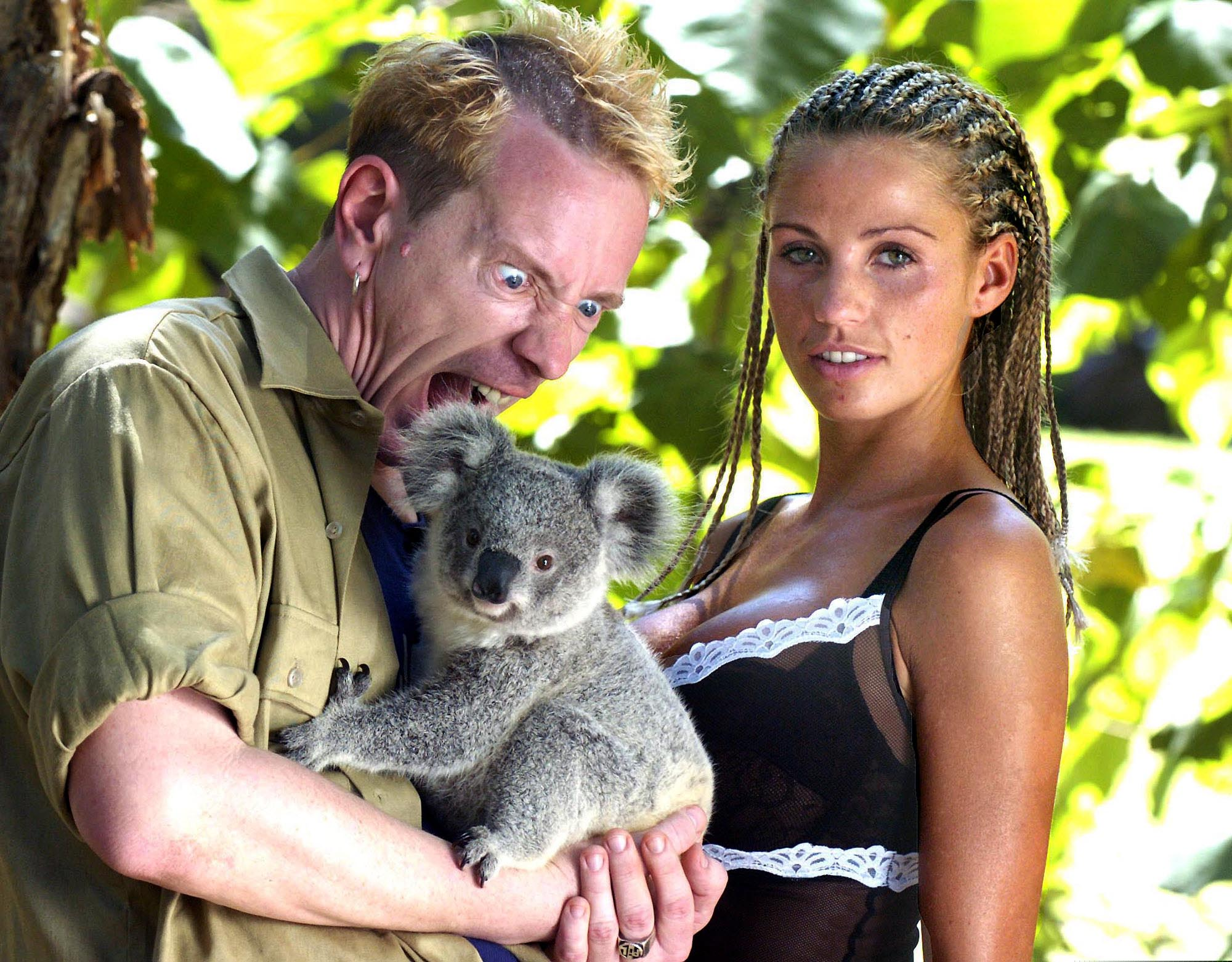 """British celebrities model Katie Price aka Jordan, right,  and Johnny """"Rotten"""" Lydon of the Sex Pistols get acquainted with a Koala at a wildlife park on the Gold Coast, Australia, Sunday, Jan. 25, 2004. The pair are competing with eight other celebrities in the British television program """"I'm a Celebrity ... Get Me Out Of Here ! """" which begins today in the Australian jungle near Murwillumbah, 200 kilometers (124 miles) south of Brisbane on Australia's east coast. Each celebrity will be voted for by the British public with the winner announced in the final show on Feb. 9. (AP Photo/Brian Cassey)"""