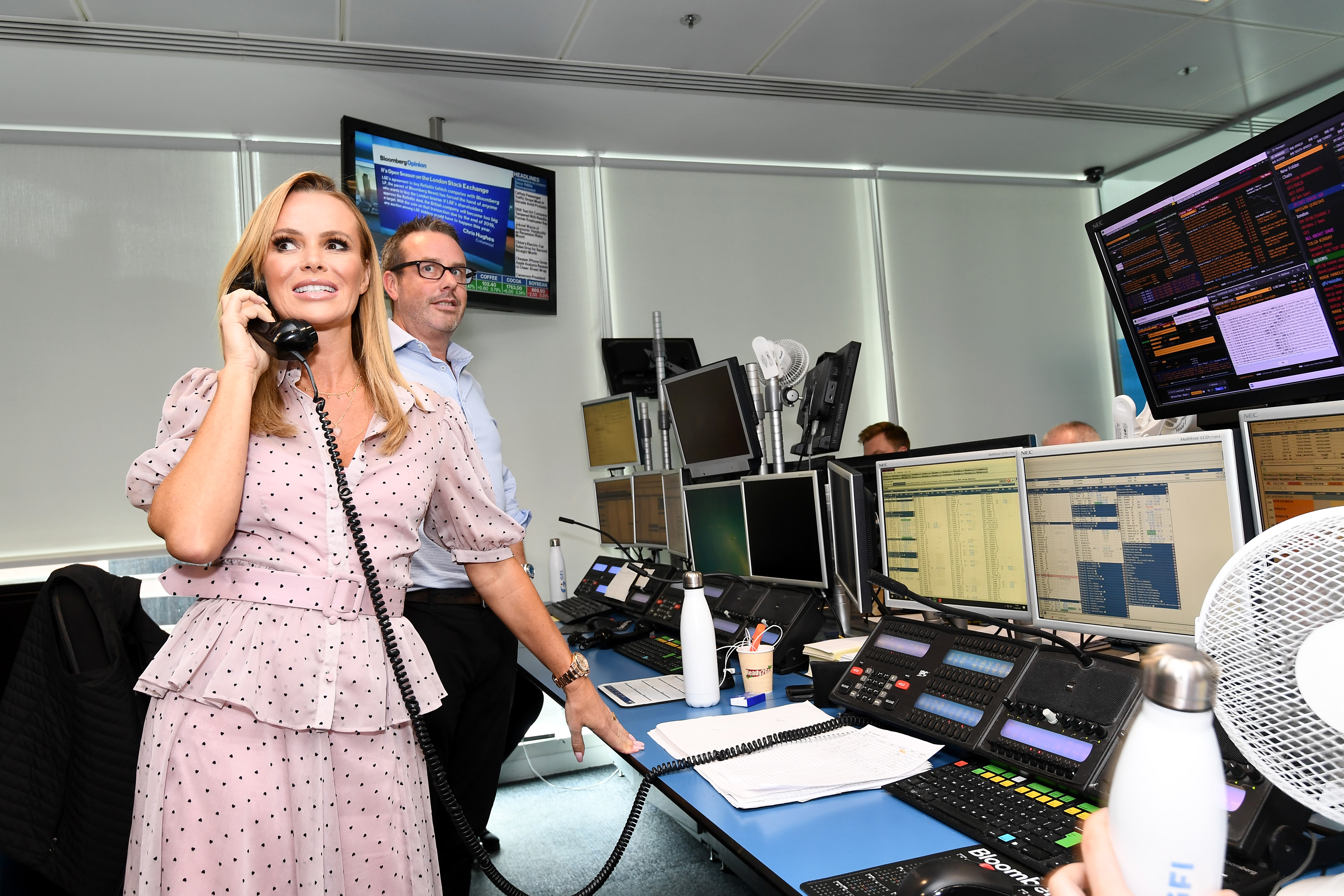LONDON, ENGLAND - SEPTEMBER 11: Amanda Holden representing Battersea Dogs and Cats, makes a trade at the GFI Charity Day to commemorate the 658 employees who perished on September 11, 2001 in the World Trade Center attacks on September 11, 2019 in London, England. (Photo by Jeff Spicer/Getty Images for GFI )