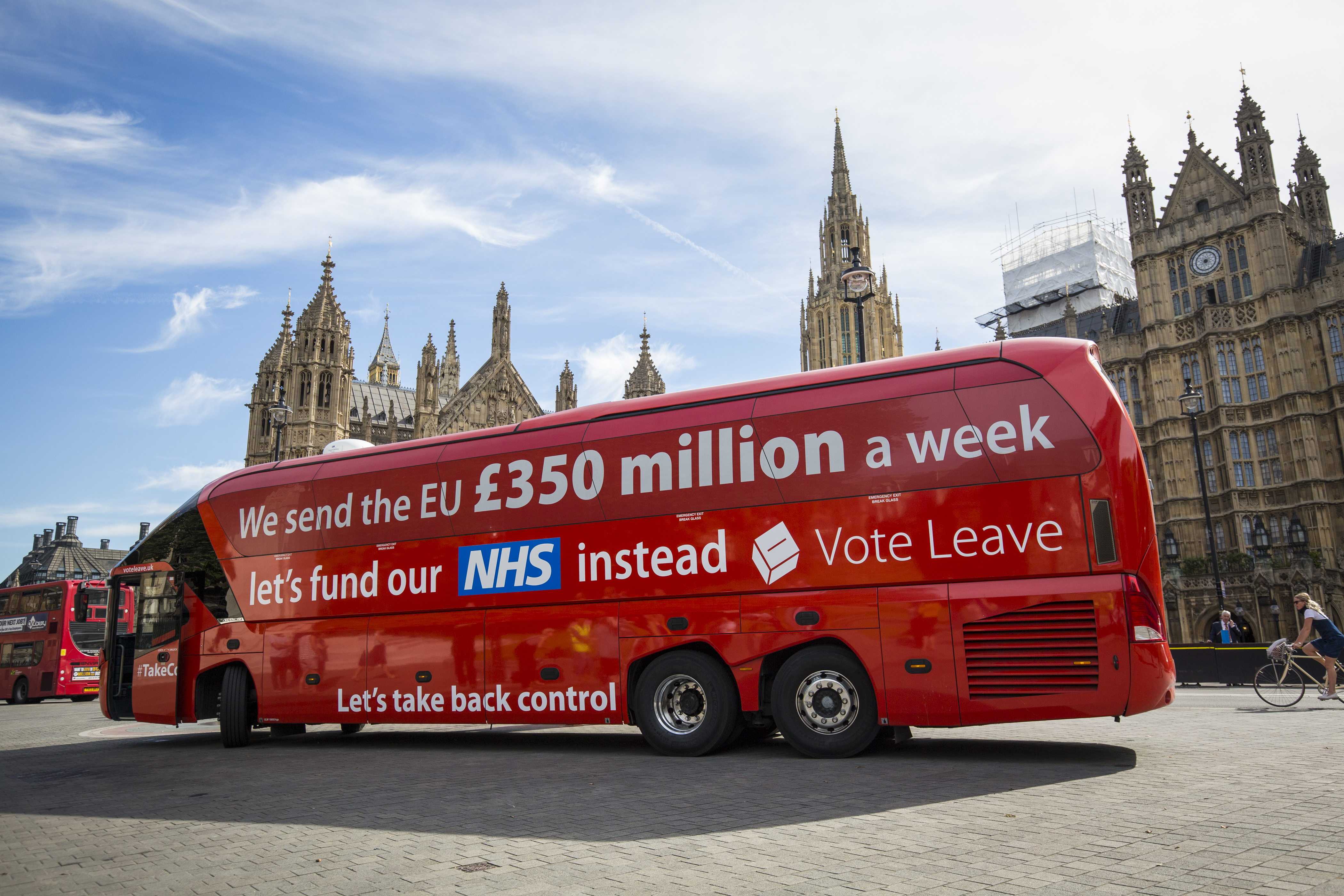 """LONDON, ENGLAND - JULY 18: A 'Vote LEAVE' battle bus is parked outside the Houses of Parliament in Westminster by the environmental campaign group Greenpeace before being re-branded on July 18, 2016 in London, England. The bus which was used during the European Union (EU) referendum campaign and had the statement """"We send the EU £350 million a week let's fund our NHS instead"""" along the side was today covered with thousands of questions for the new Prime Minister Theresa May and her government about what a 'Brexit' might mean for the environment. (Photo by Jack Taylor/Getty Images)"""